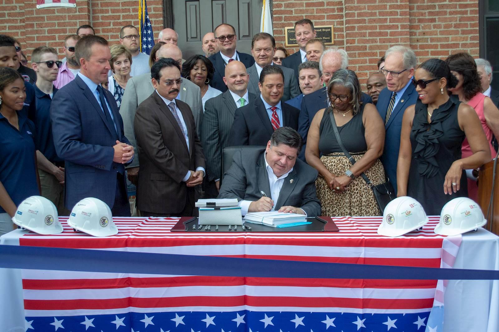Gov. J.B. Pritzker signs the capital infrastructure plan.