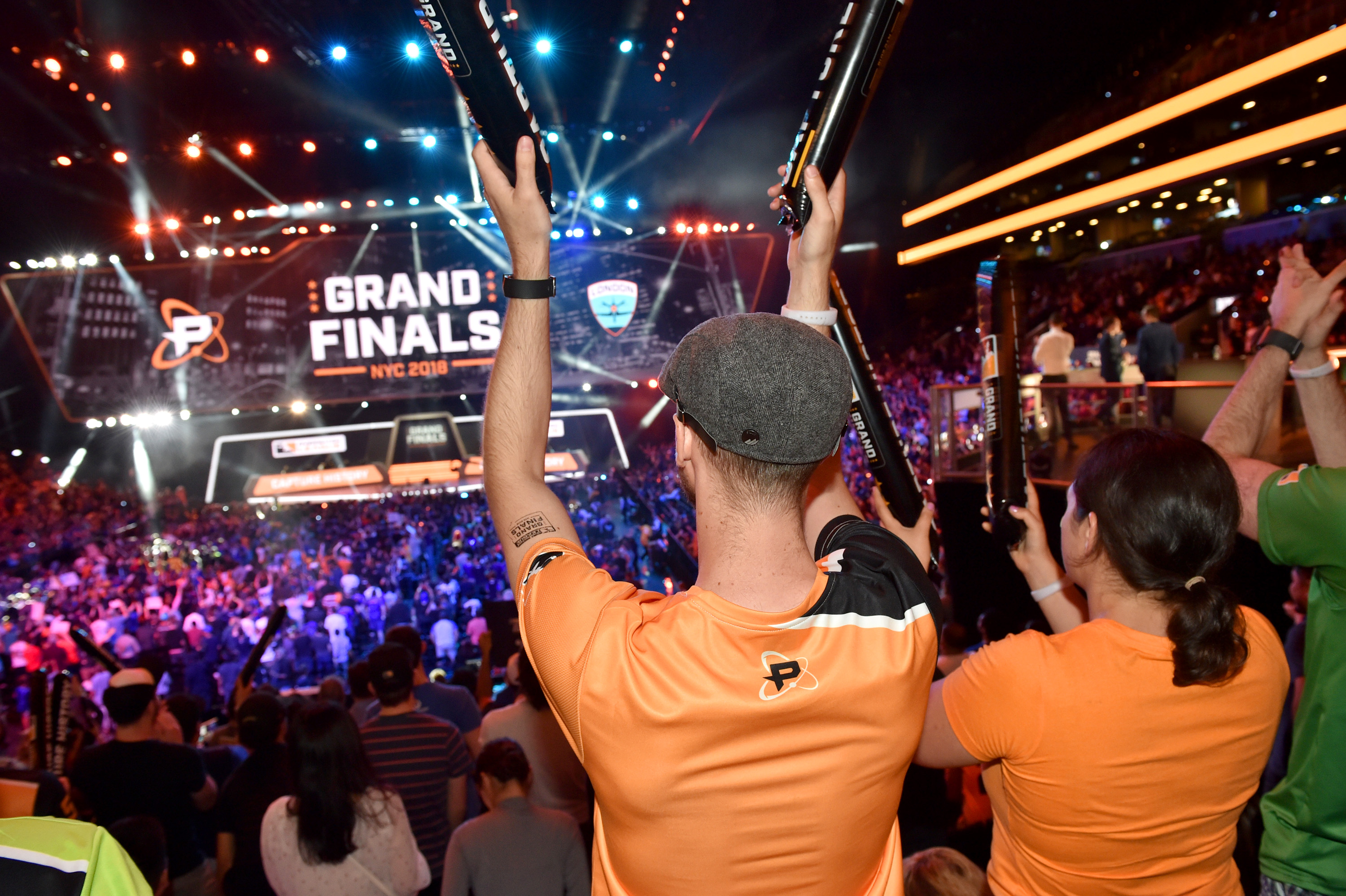 fans cheering at the Overwatch League Grand Finals