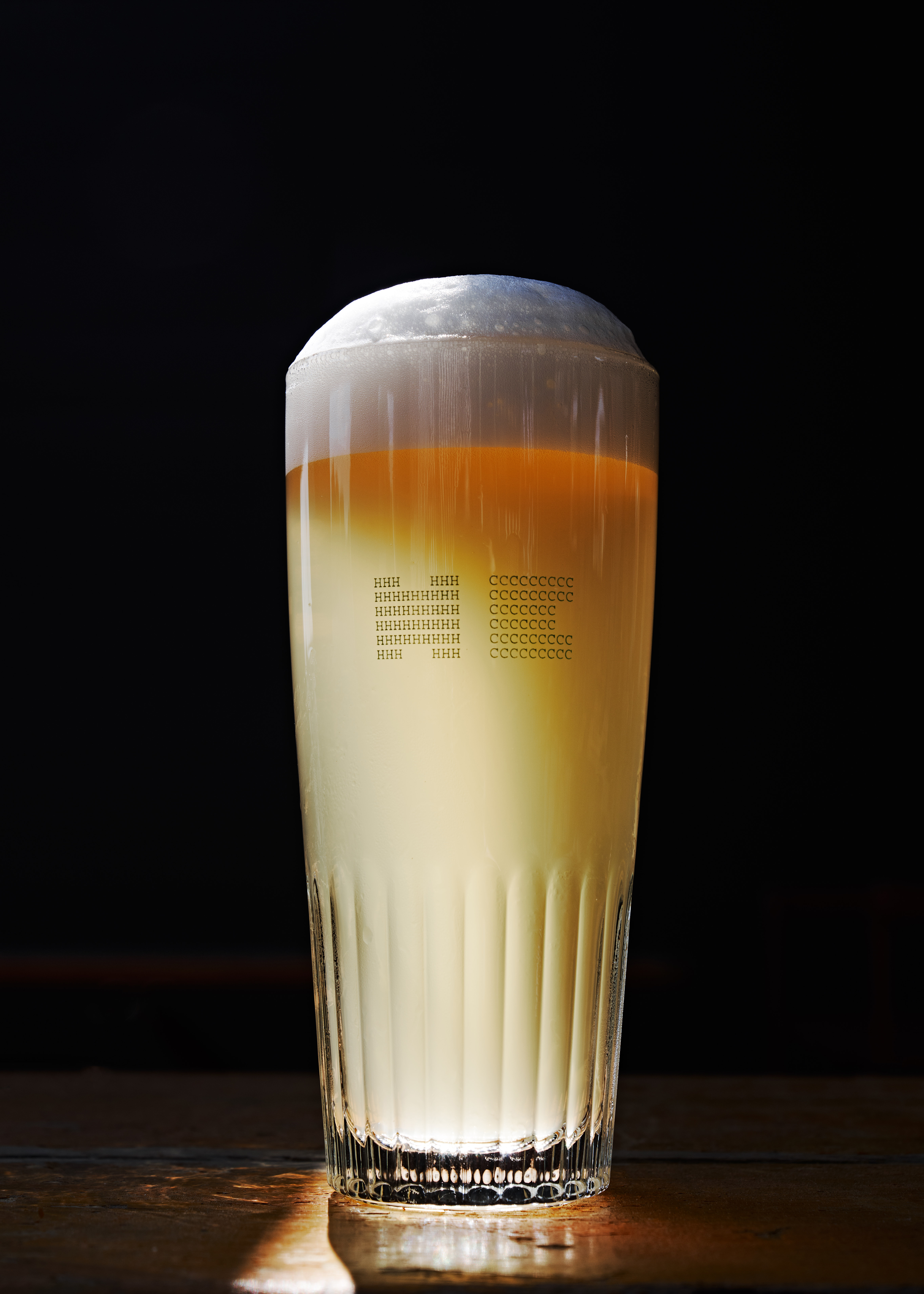 A pint of beer with head against a black background at Halfway Crooks Brewing in Summerhill