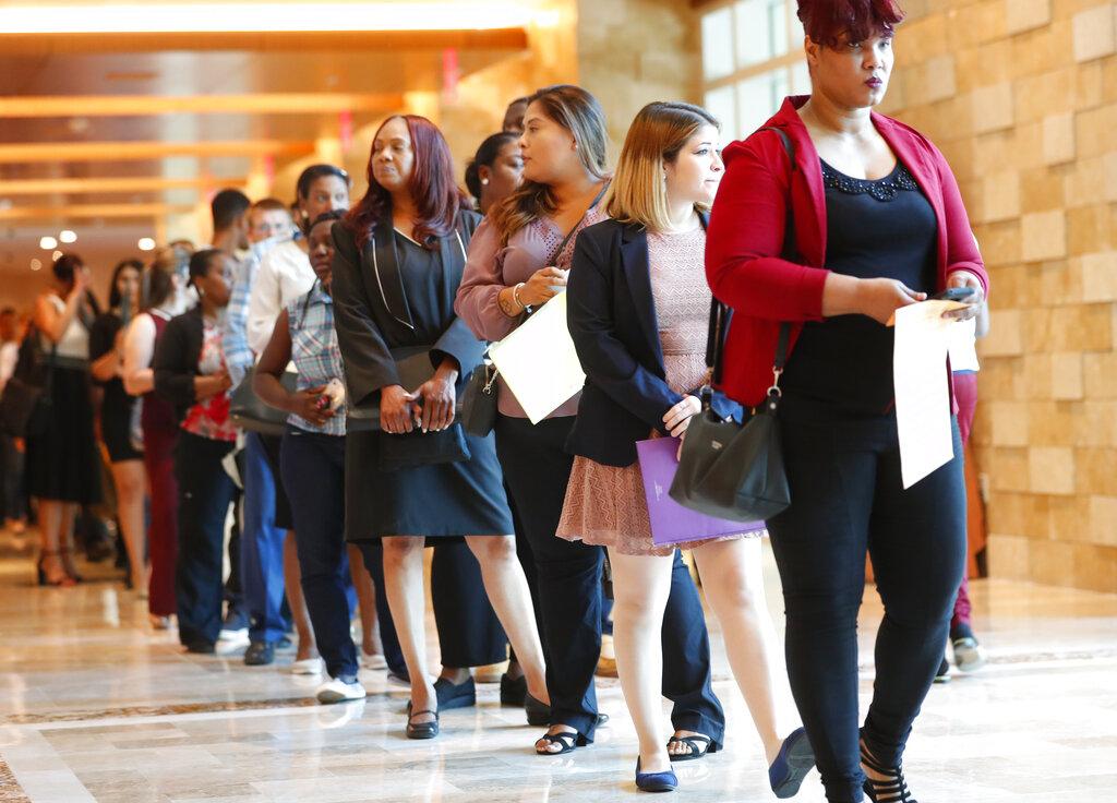 dfa07a89f41c76 Job applicants wait in line during a job fair in Hollywood, Florida