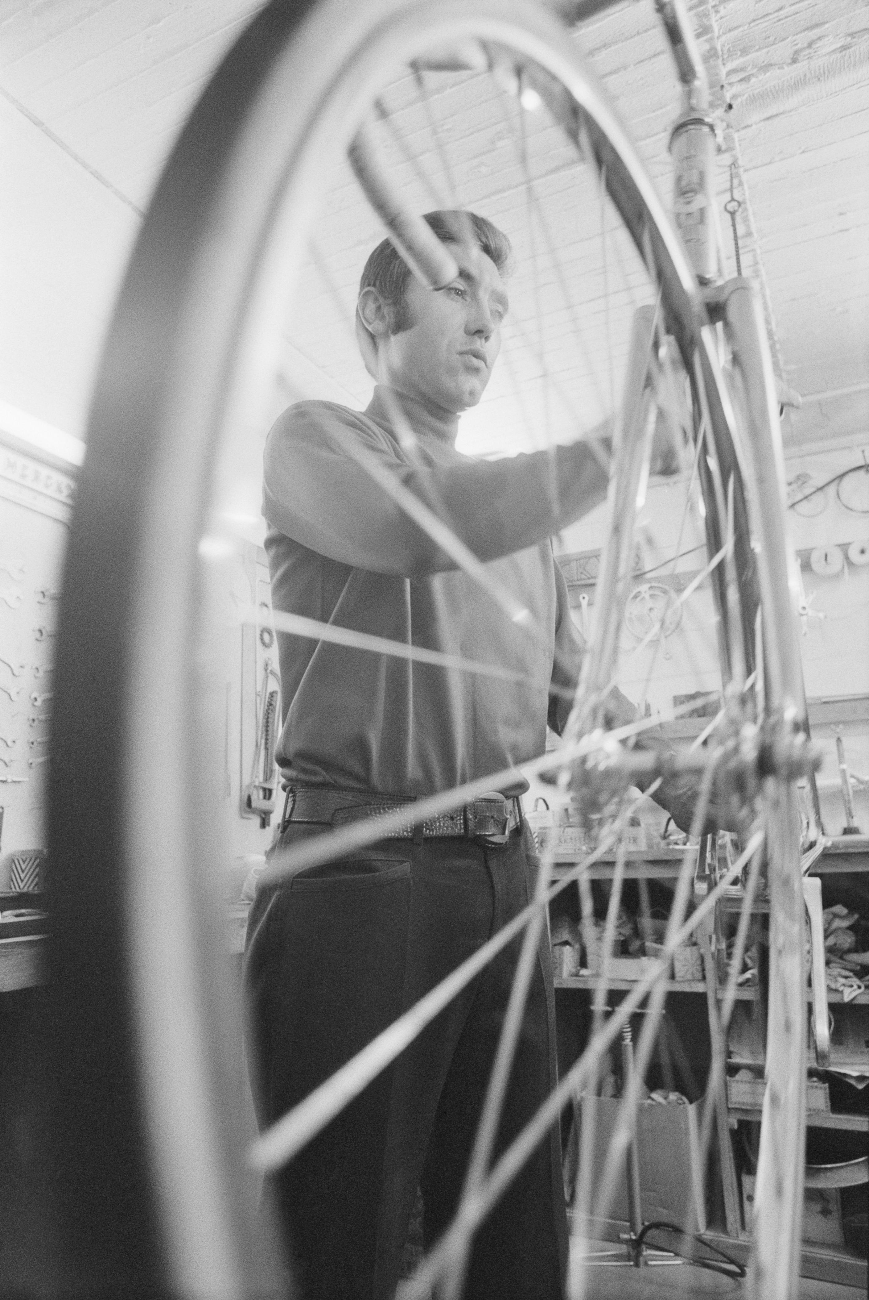 Eddy Merckx Repairing Bicycle