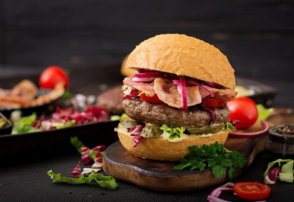 A bacon-topped burger at Sidecar Social