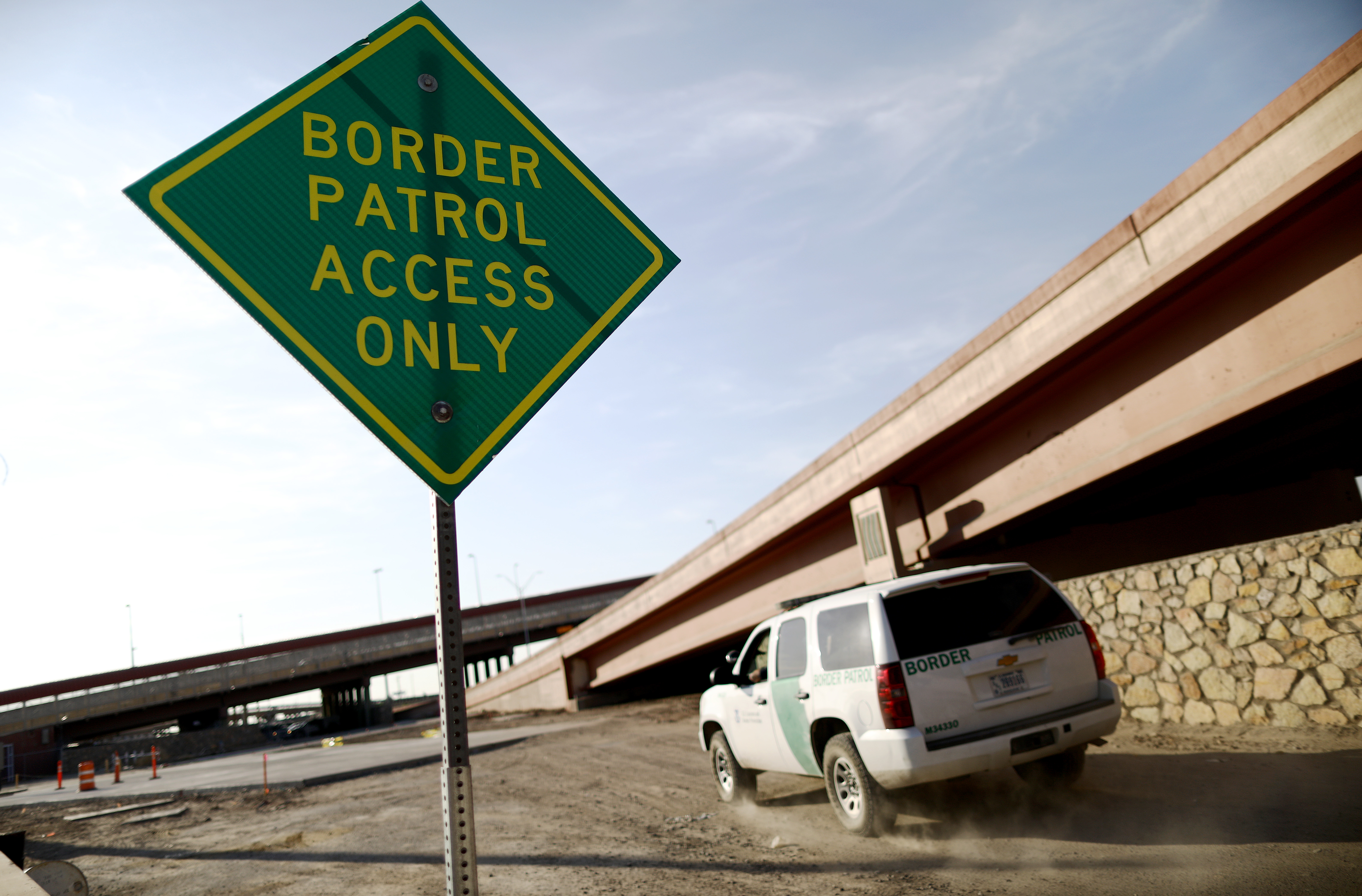 Border Patrol vehicle passes a 'Border Patrol Access Only' sign near the U.S.-Mexico border on June 26, 2019 in El Paso, Texas.