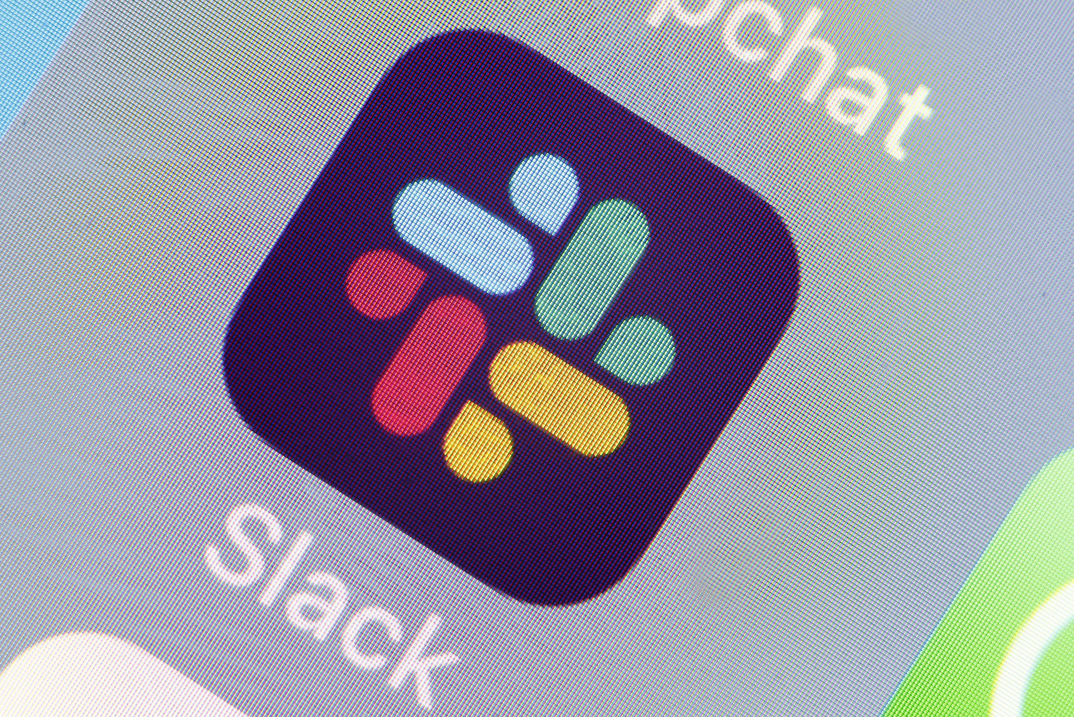 The Slack icon on a phone screen.