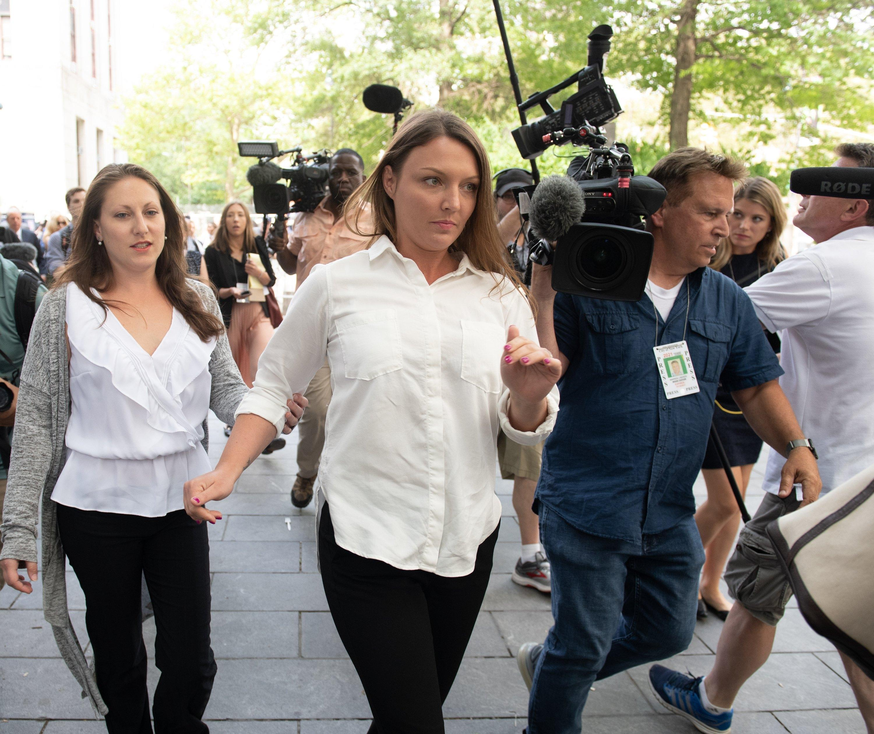 Victims of Jeffrey Epstein from the Miami criminal case, Michelle Licata, left, and Courtney Wild, leave a New York City federal courthouse on July 8, 2019.