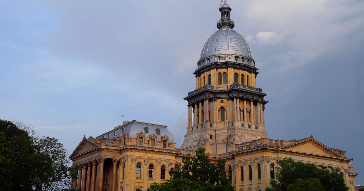 the Illinois State Capitol is seen during sunset in Springfield,