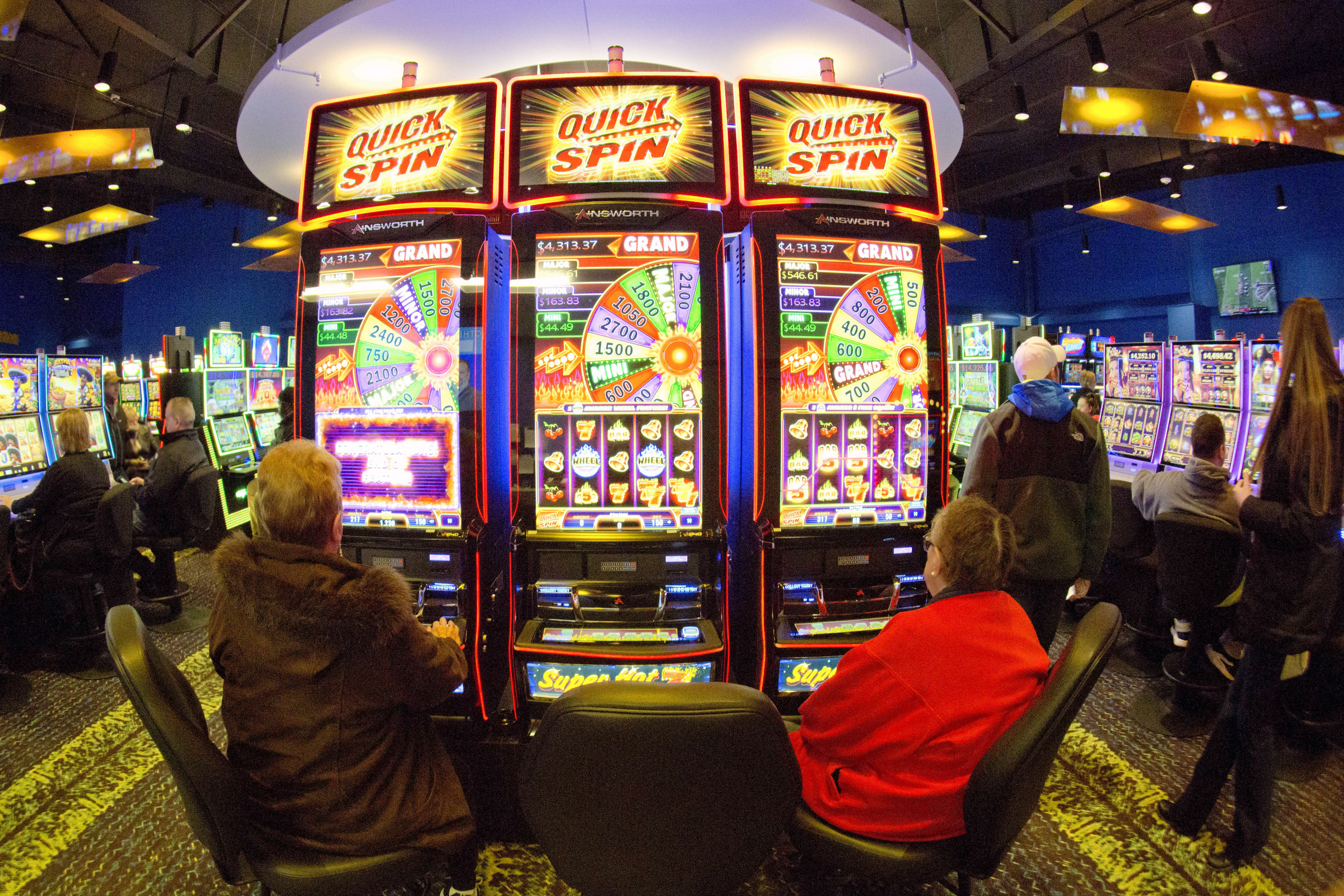 Gamblers play the slots at the Ponca Tribe's Prairie Flower Casino in Carter Lake, Iowa, in February. Lawmakers have said a Chicago casino could be up and running from a temporary site within a year, but state officials have already missed their first dea