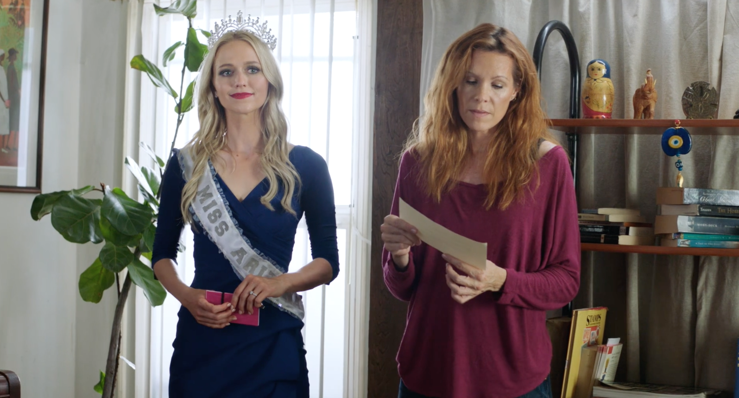 """Robyn Lively as one of the residents of a women's shelter introduces guest speaker and former pageant winner Johanna Braddy in """"Miss Arizona."""""""