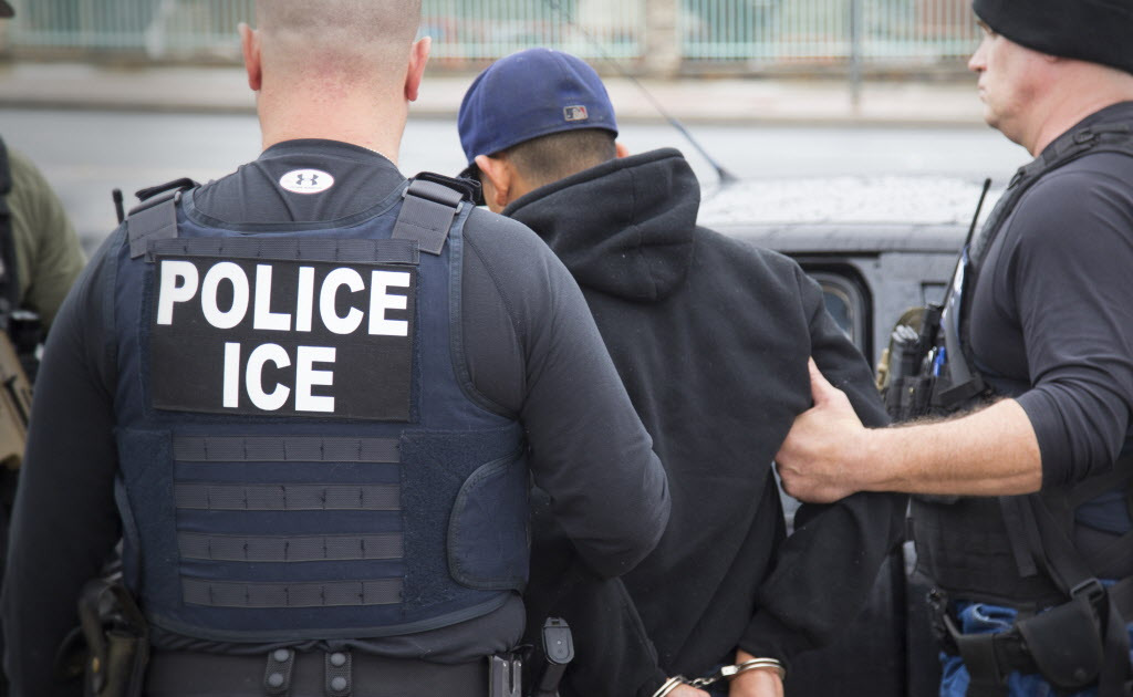 In this file photo, Immigration and Customs Enforcement agents make an arrest in February, 2017, in Los Angeles.