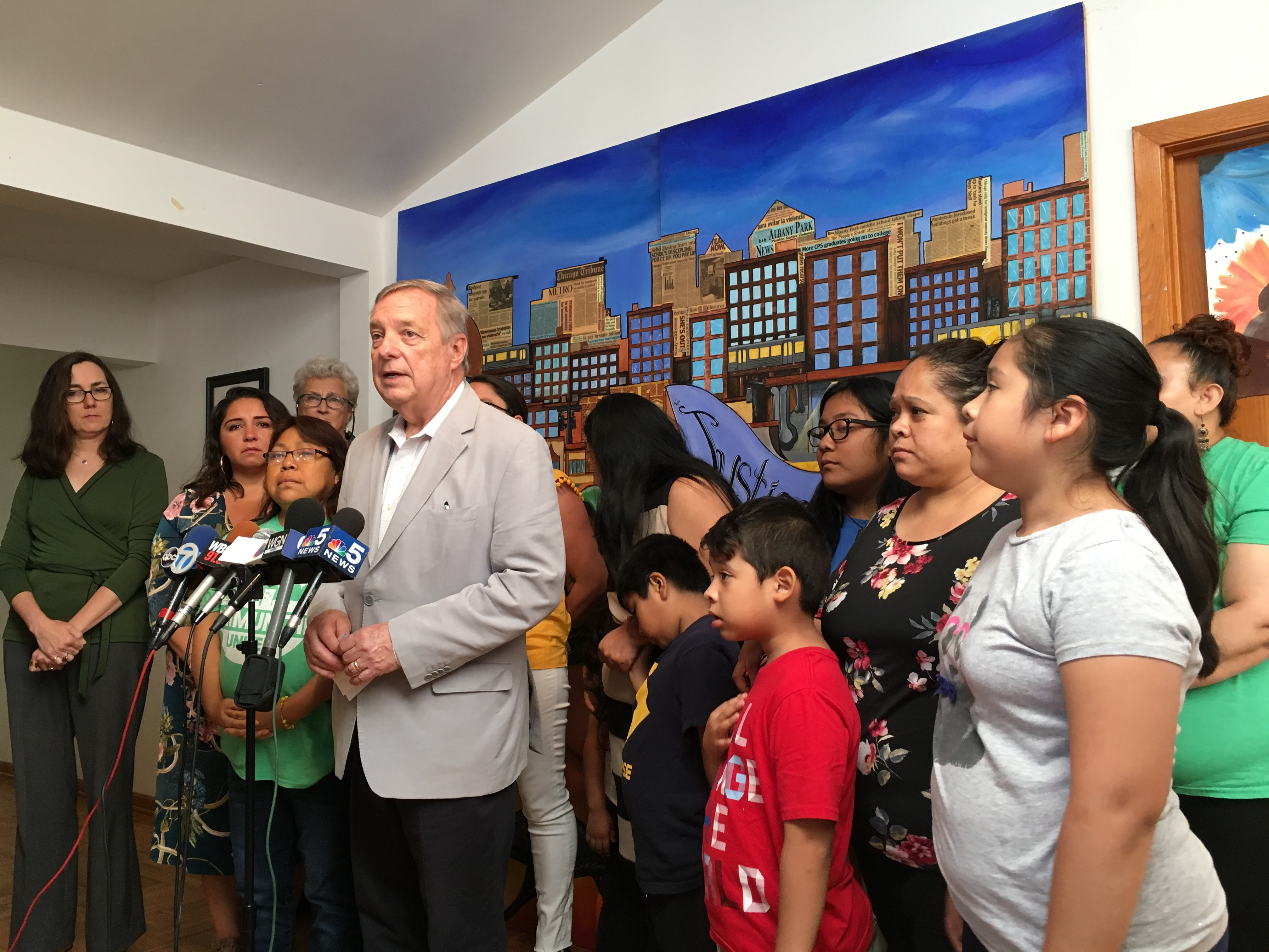 Sen. Dick Durbin (center) flanked by members of Communities United at their offices in Albany Park, July 12, 2019.