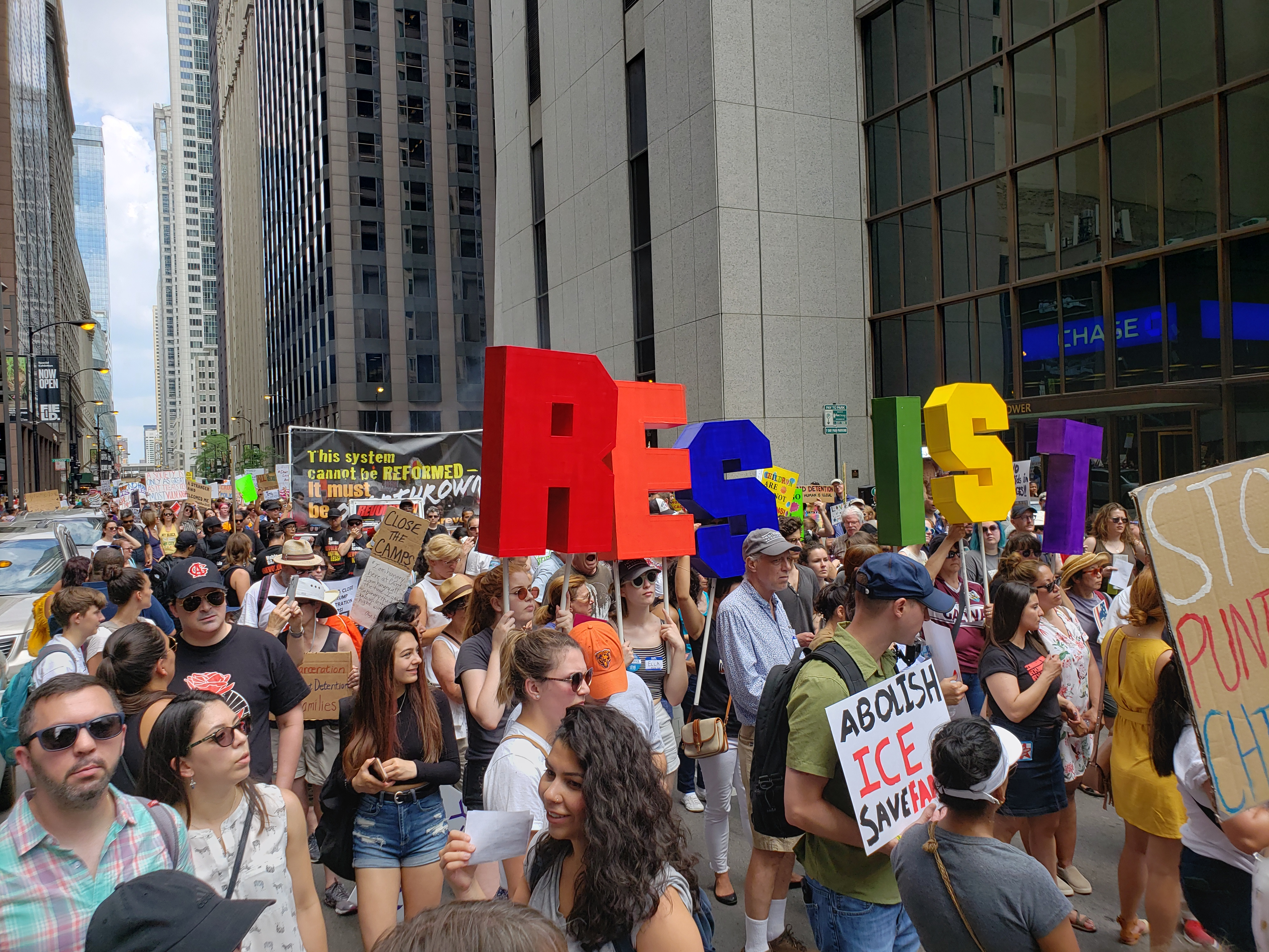 Demonstrators make their way through the Loop on Saturday to protest the Trump administration's immigration policies.