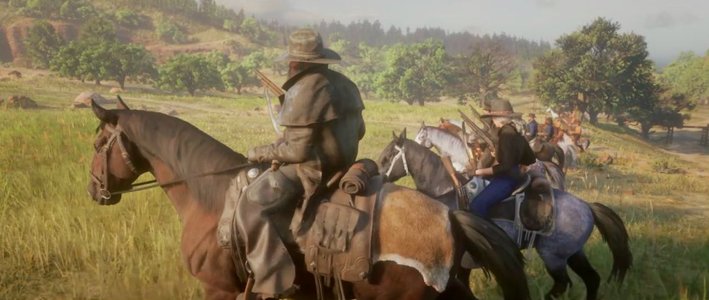 a line of armed horseback riders on the plains in Red Dead Online