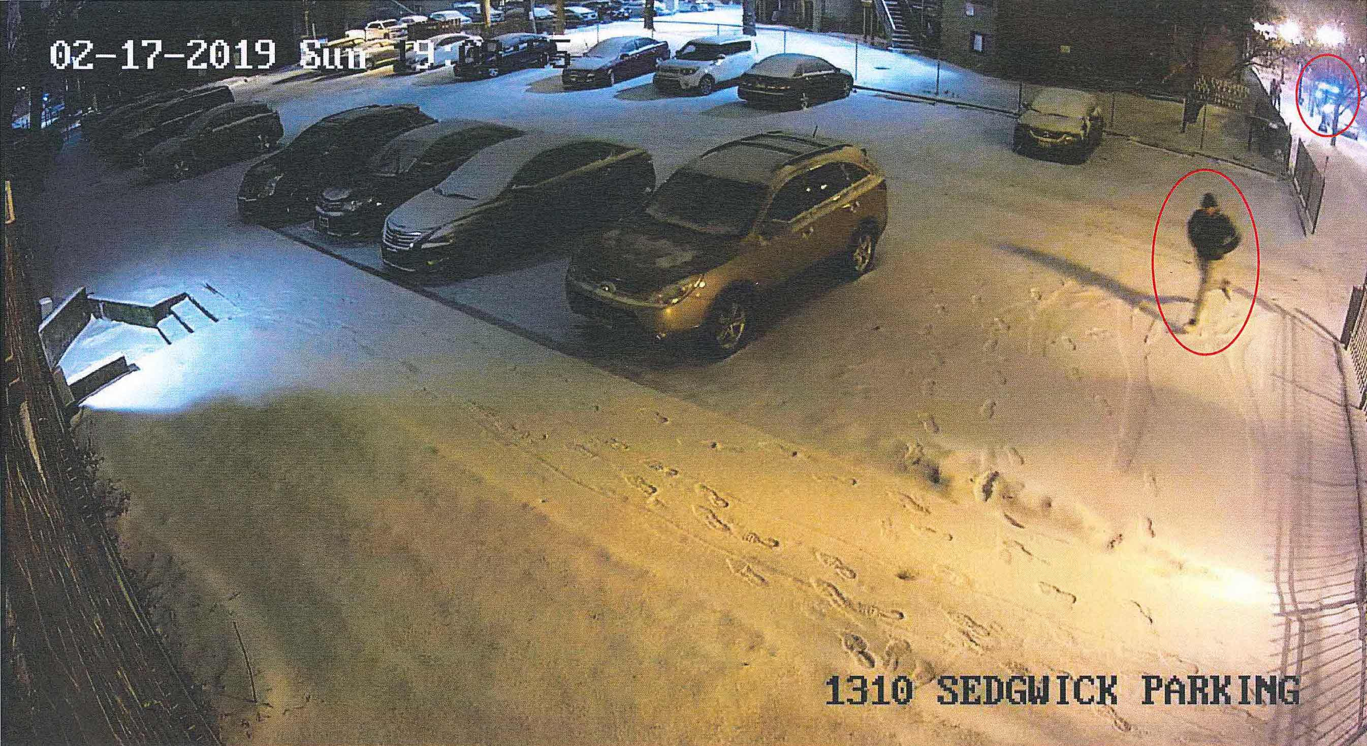 Still from a surveillance video allegedly showing Gaston Tucker running through a parking lot after fleeing a traffic stop Feb. 17, 2019, in Old Town.