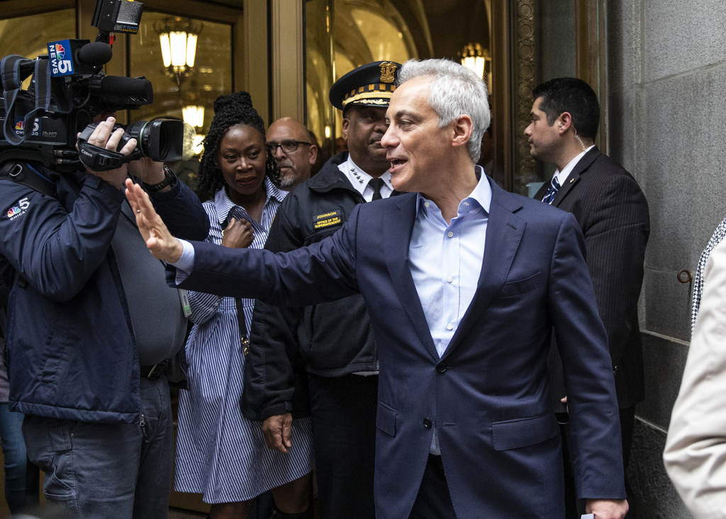 Rahm Emanuel waves to staffers, department heads and supporters as walks out of City Hall on his last full day as mayor of Chicago, Friday afternoon, May 17, 2019.