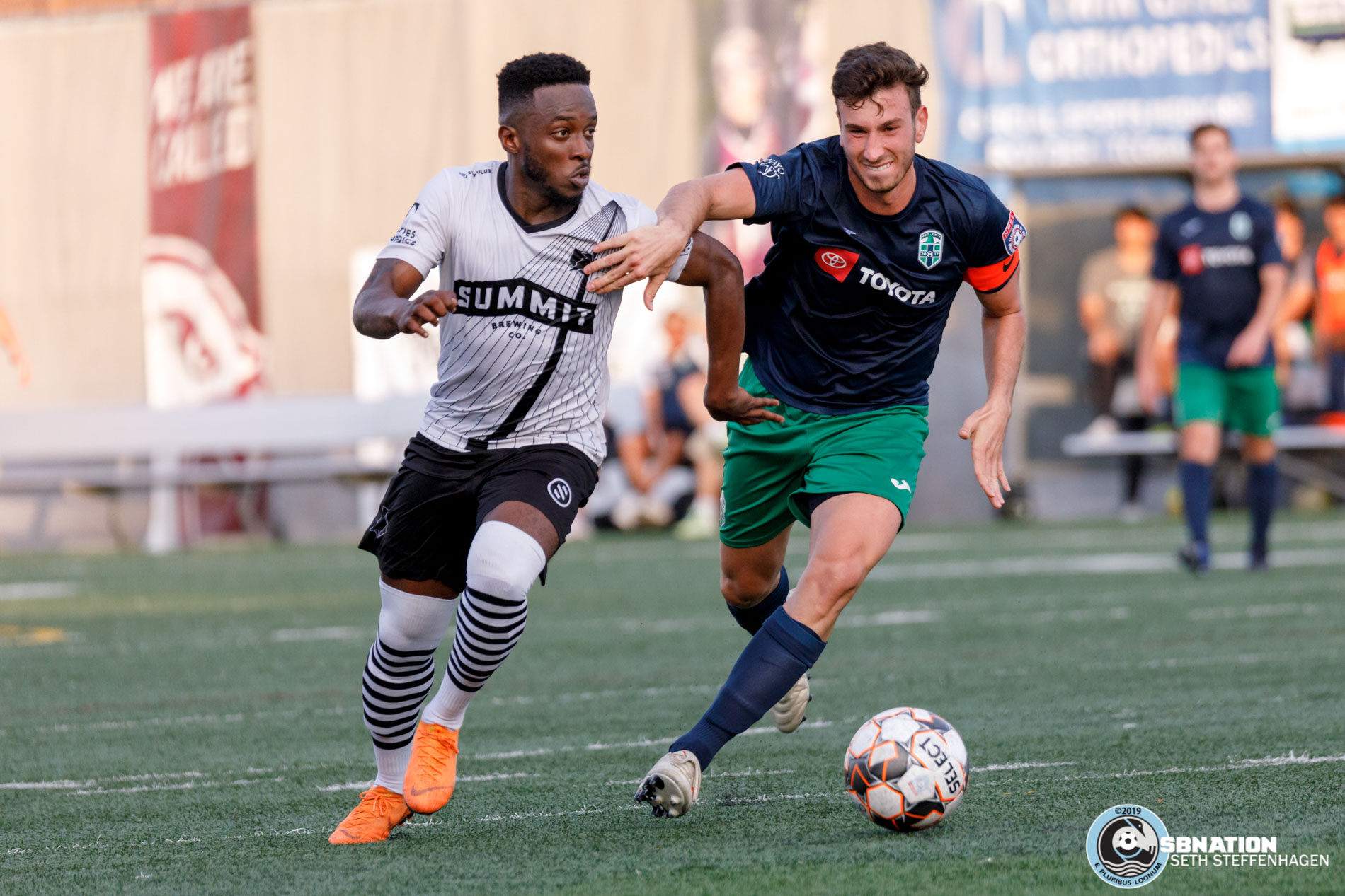July 12, 2019 - Minneapolis, Minnesota, United States - Minneapolis City SC forward Whitney Browne (10) dribbles around Med City FC player Nicholas Itopoulos during a match at Edor Nelson Field.