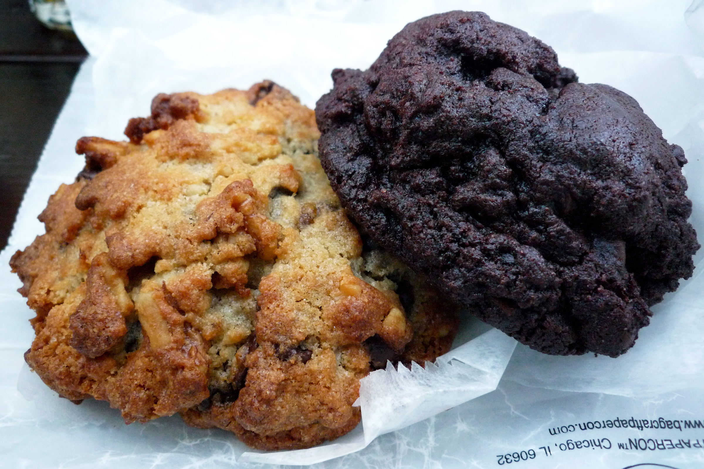 two voluminous and large cookies by levain bakery