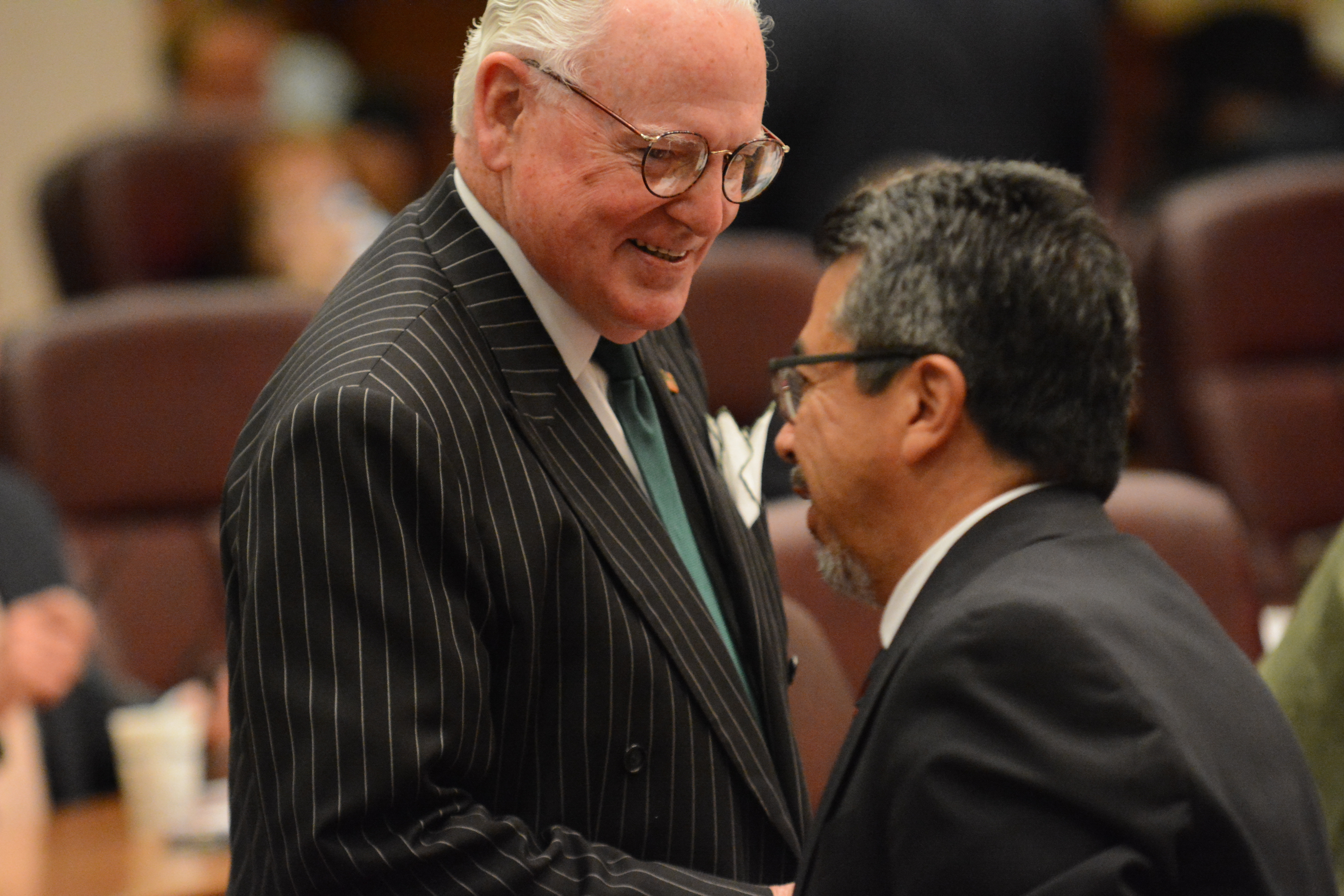 Former Ald. Danny Solis (25th) (right) jokes with Ald. Edward Burke (14th) at a 2016 Chicago City Council meeting.