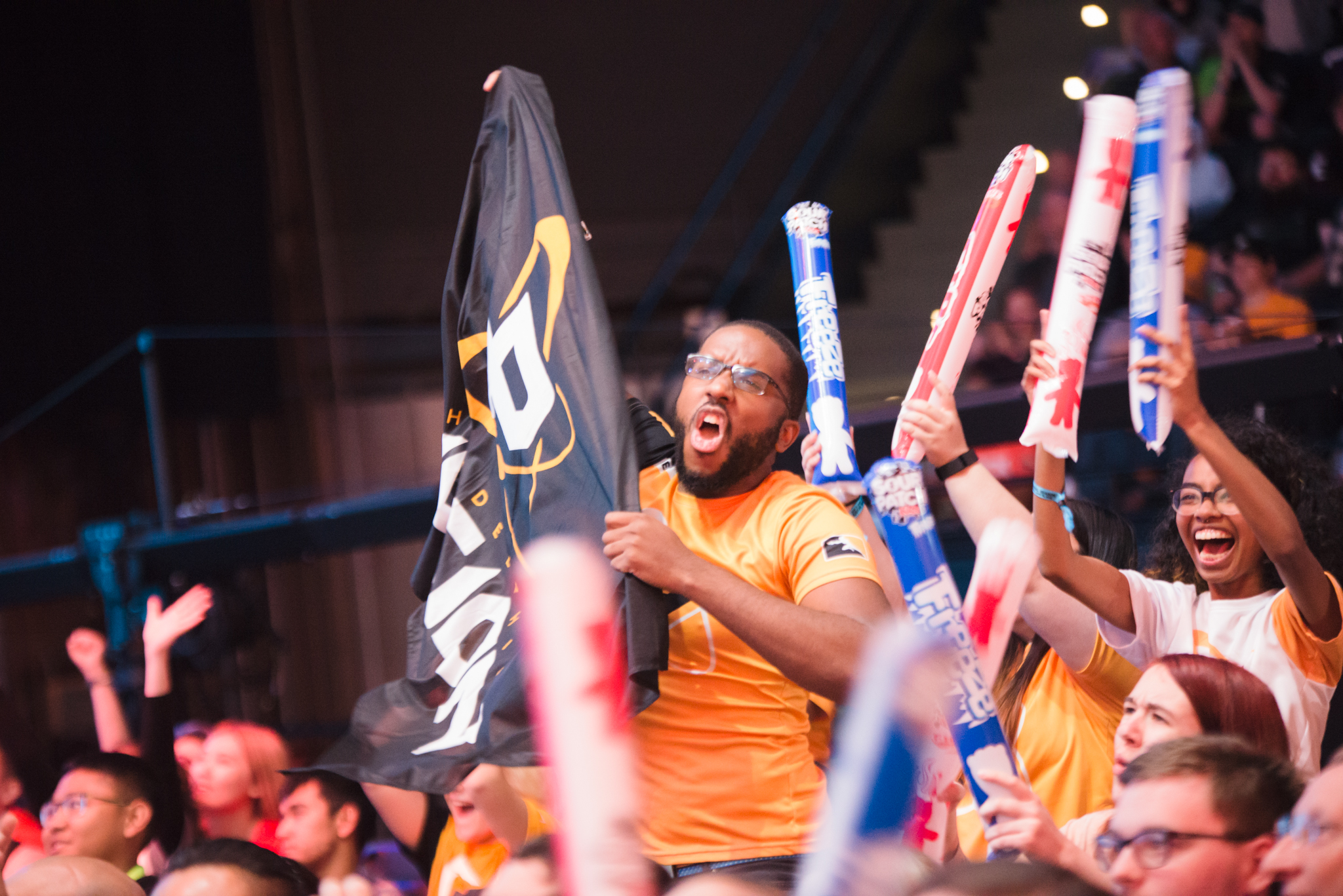 A fan cheers for the Philadelphia Fusion at an Overwatch League game