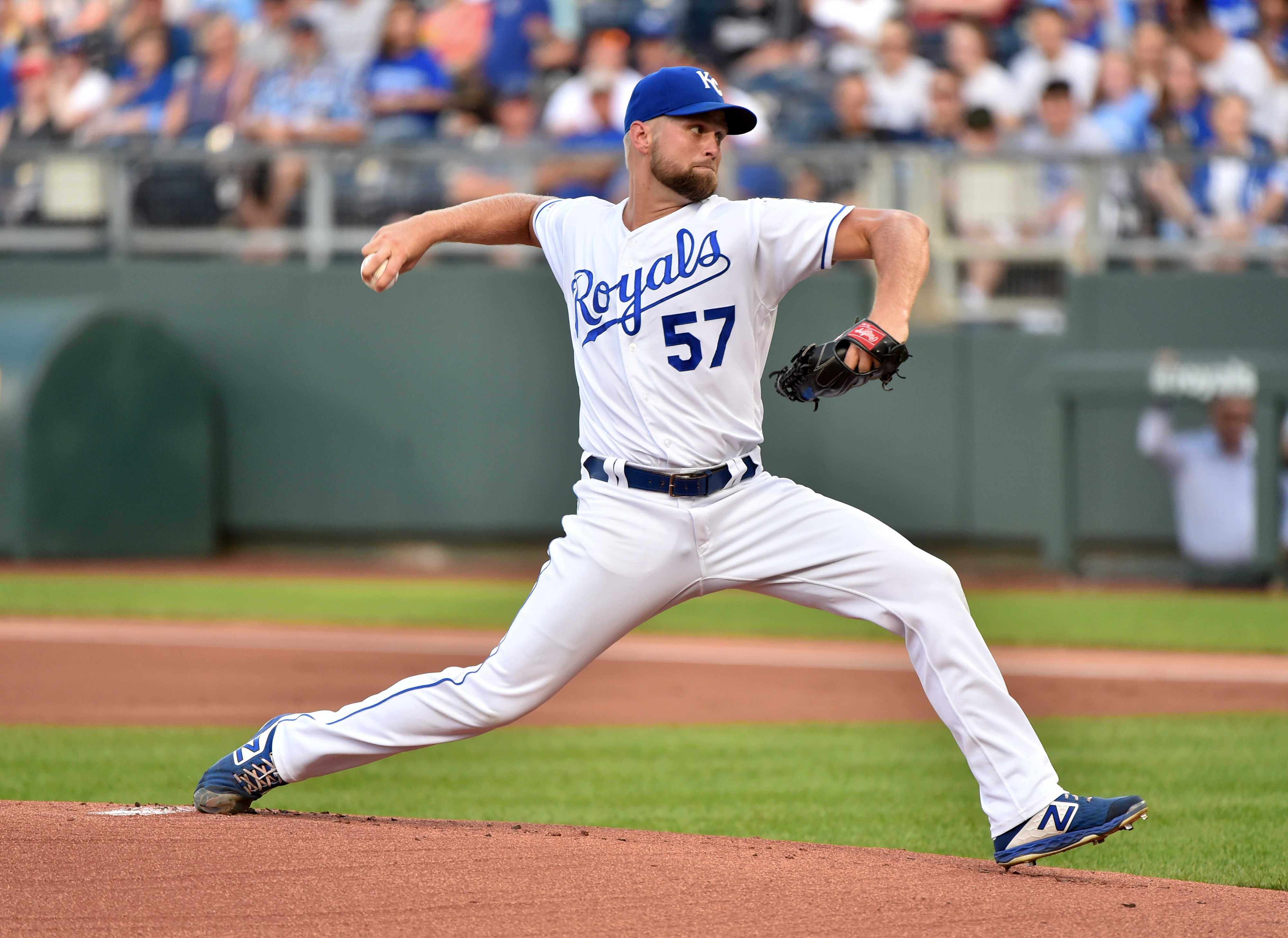 Starting pitcher Glenn Sparkman #57 of the Kansas City Royals throws in the first inning against the Chicago White Sox at Kauffman Stadium on July 16, 2019 in Kansas City, Missouri.