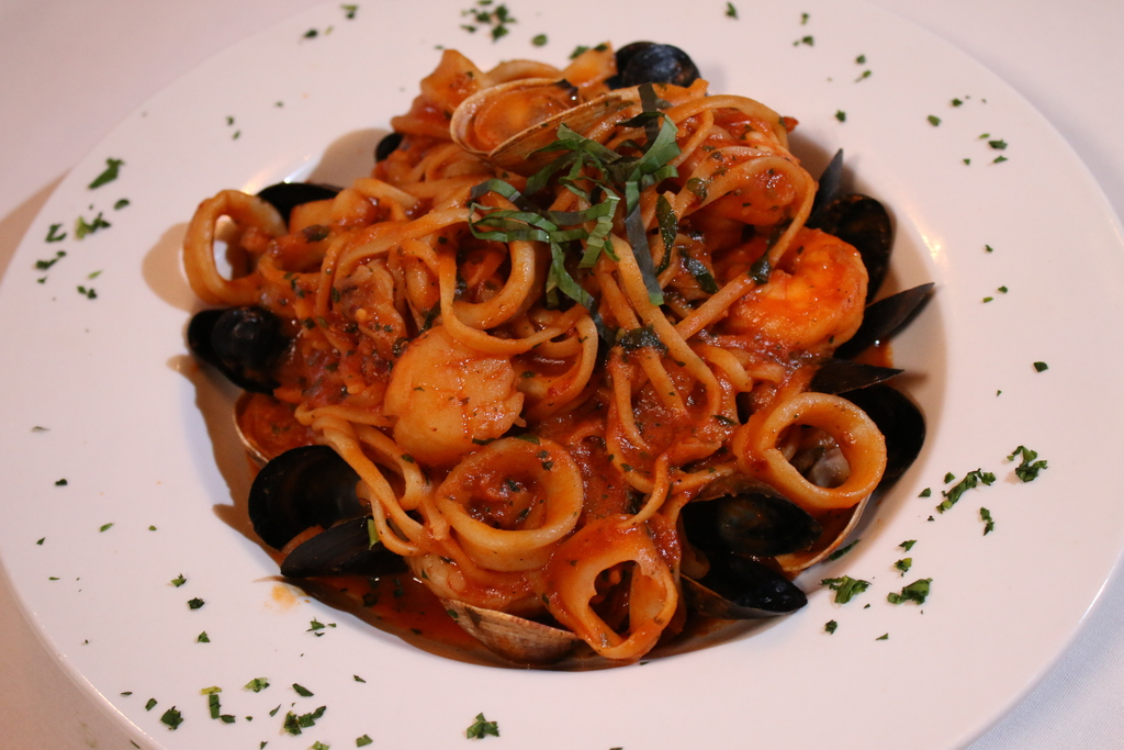 TheLinguini Frutti Di Mare, served at Frankie's Ristorante, is made with long strand pasta, mussels, clams, calamari, shrimp, and scallops in red sauce.