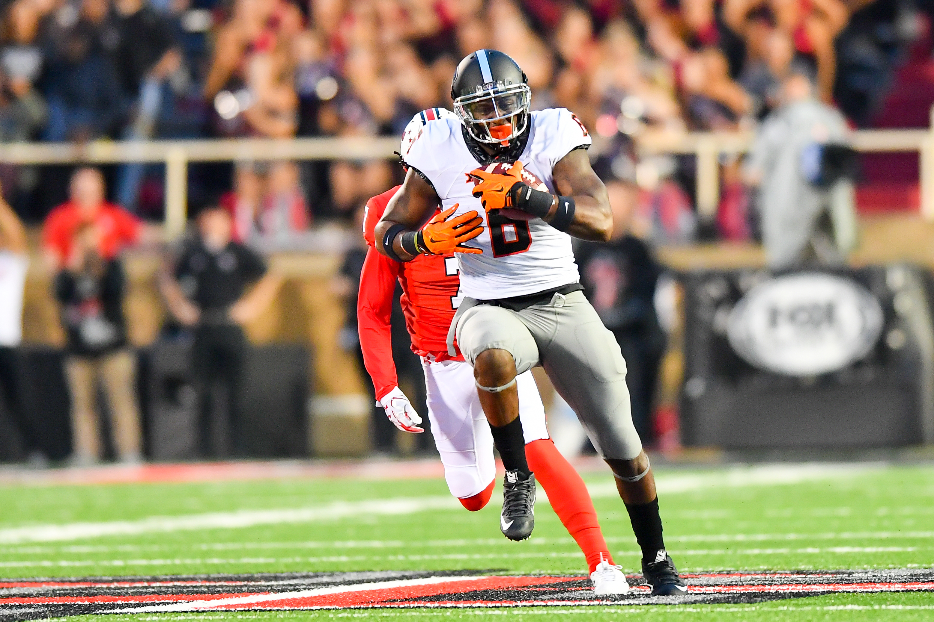 Former Oklahoma State Cowboys WR Keenen Brown breaks away from Texas Tech Red Raiders S Jah'Shawn Johnson, Sep. 30, 2017.
