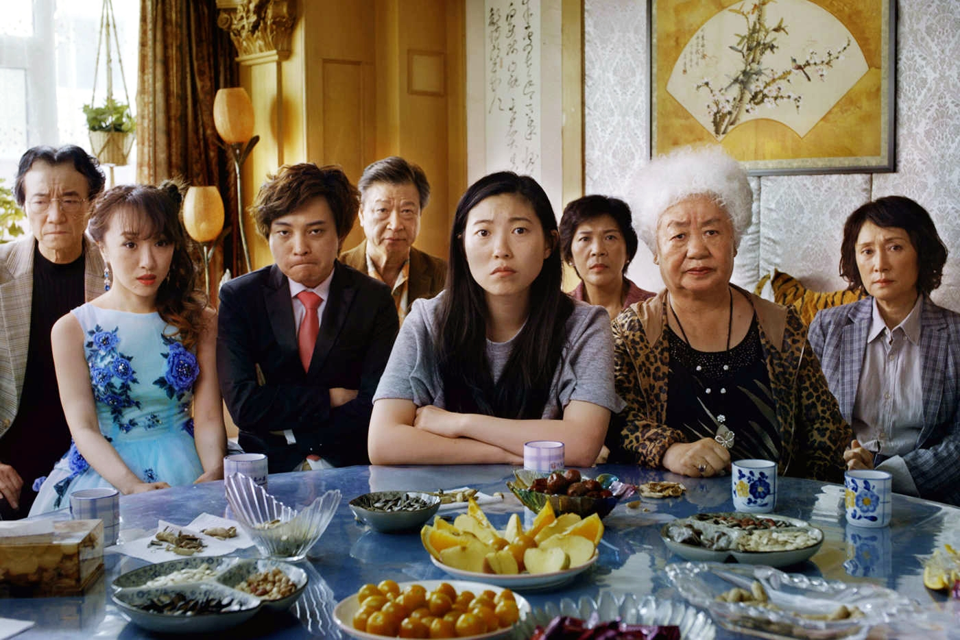 The Farewell's main character Bili and her family sit at a dining table in their home in China.