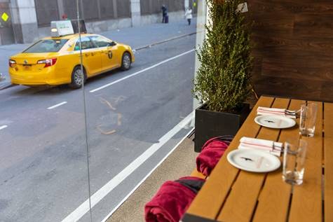 NYC's Latest Absurd Restaurant Gimmick Is Dining Inside a Glass Truck