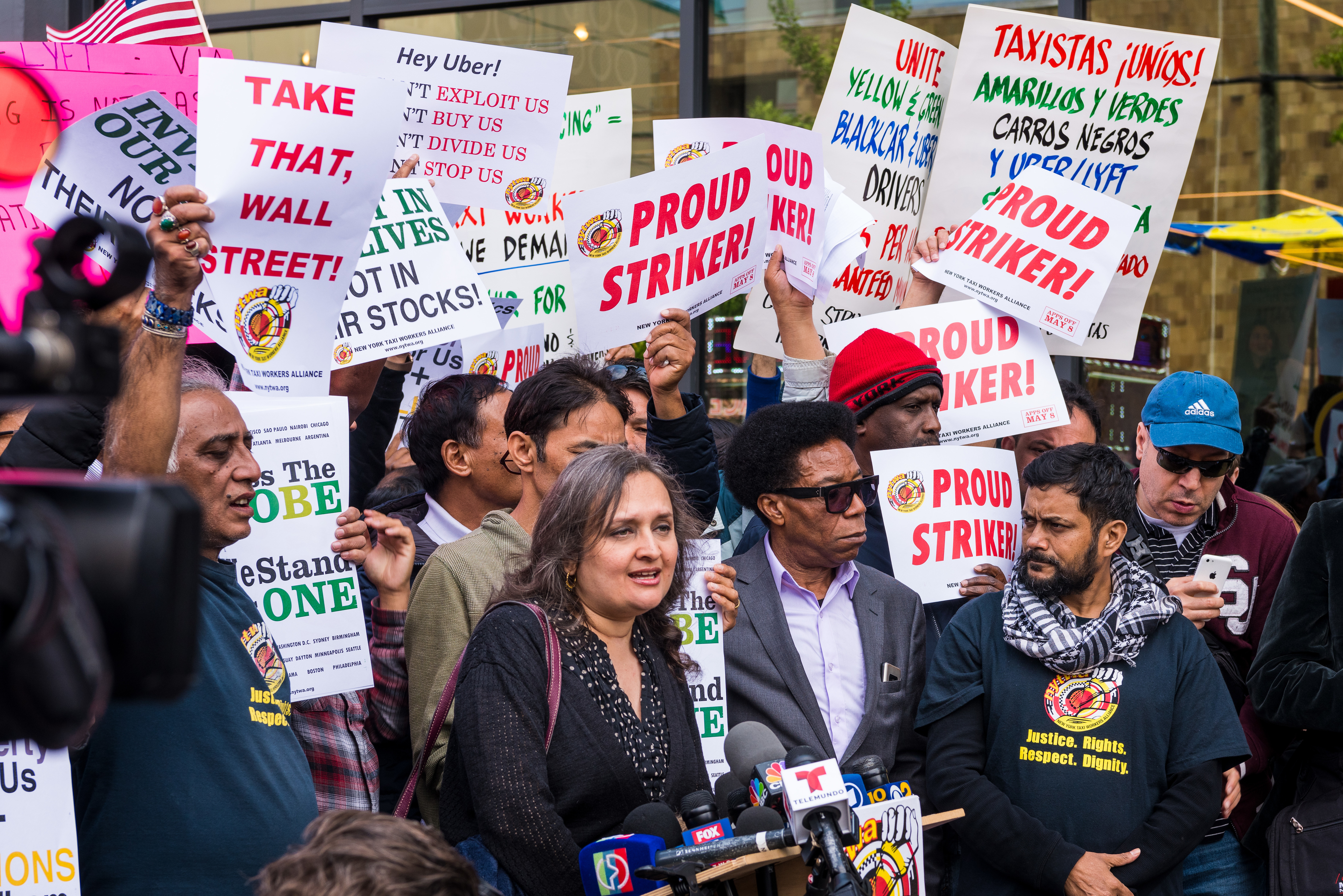 NYC cab drivers rallied in front of the Uber and Lyft