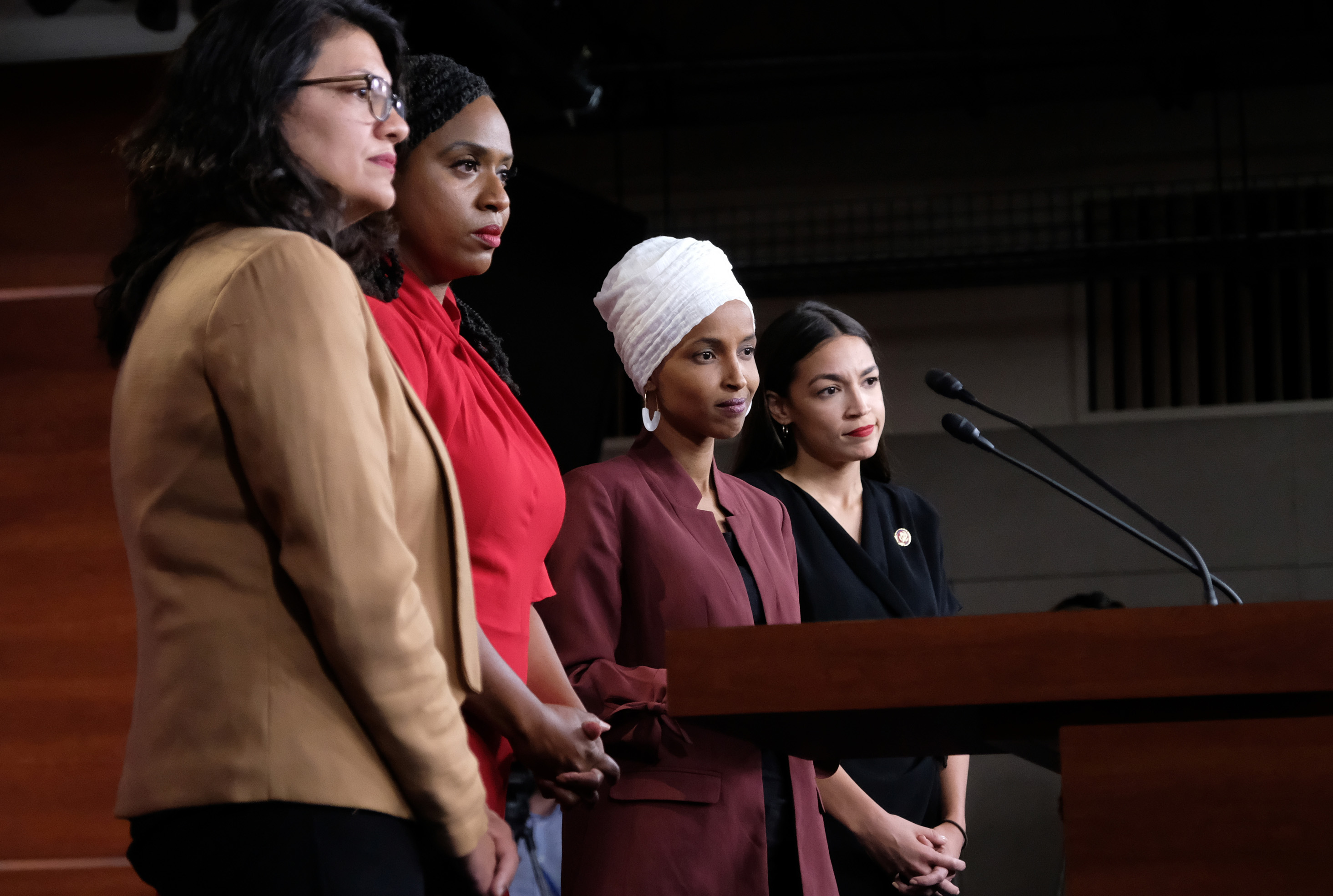 U.S. Rep. Rashida Tlaib (D-MI), Rep. Ayanna Pressley (D-MA), Rep. Ilhan Omar (D-MN), and Rep. Alexandria Ocasio-Cortez (D-NY) at a press conference at the U.S. Capitol on July 15, 2019 in Washington, DC