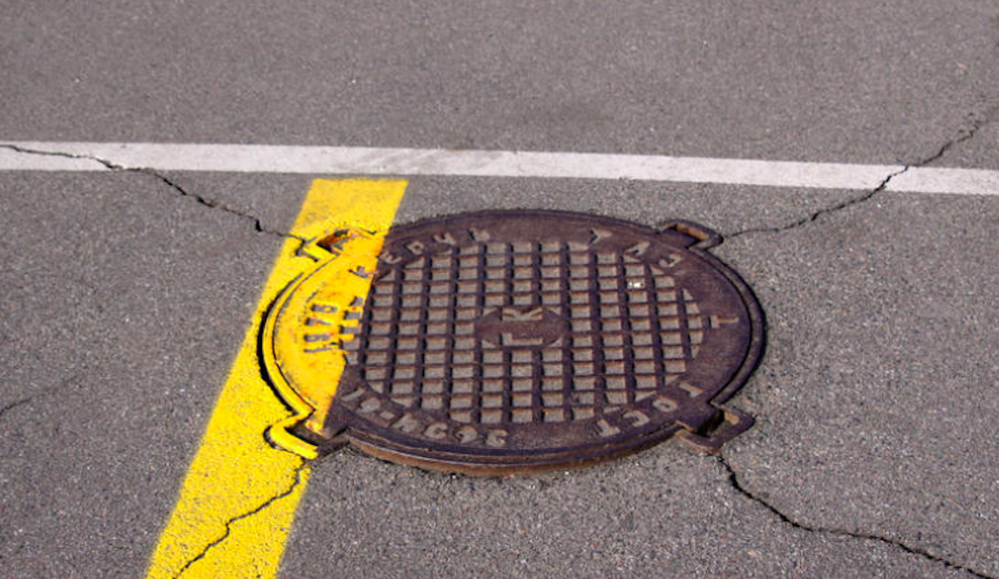 A manhole in the street.