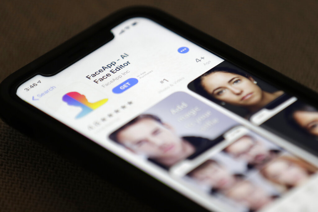 FaceApp is displayed on an iPhone Wednesday, July 17, 2019, in New York. The popular app is under fire for privacy concerns.