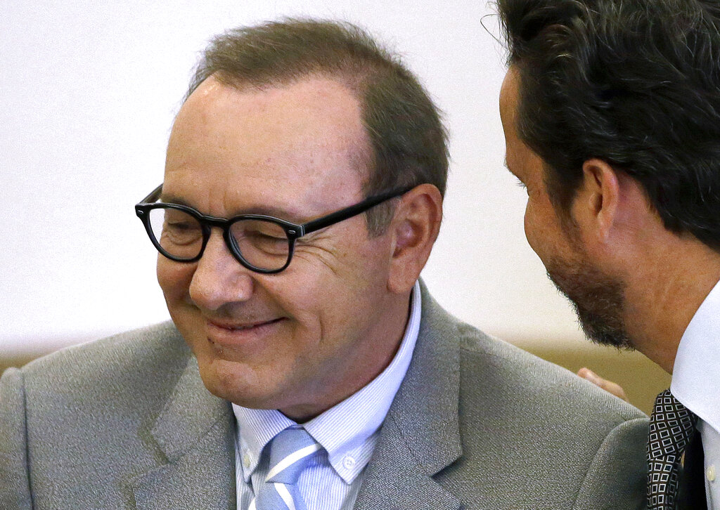 Actor Kevin Spacey listening to attorney Alan Jackson in Nantucket, Mass.