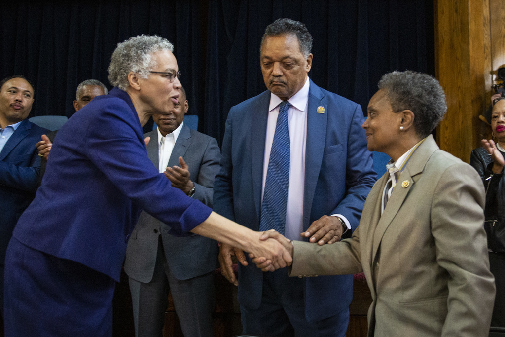 Lori Lightfoot, right, shakes hands with former mayoral candidate Cook County Board President Toni Preckwinkle