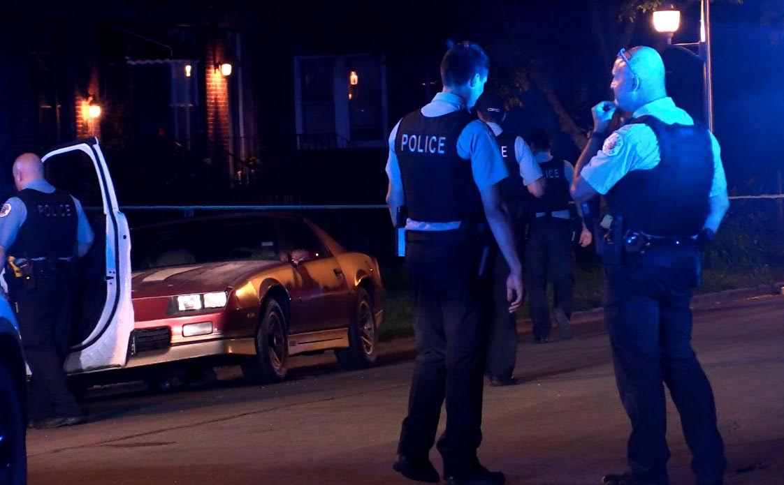 Police investigate the scene of a shooting in Garfield Park.