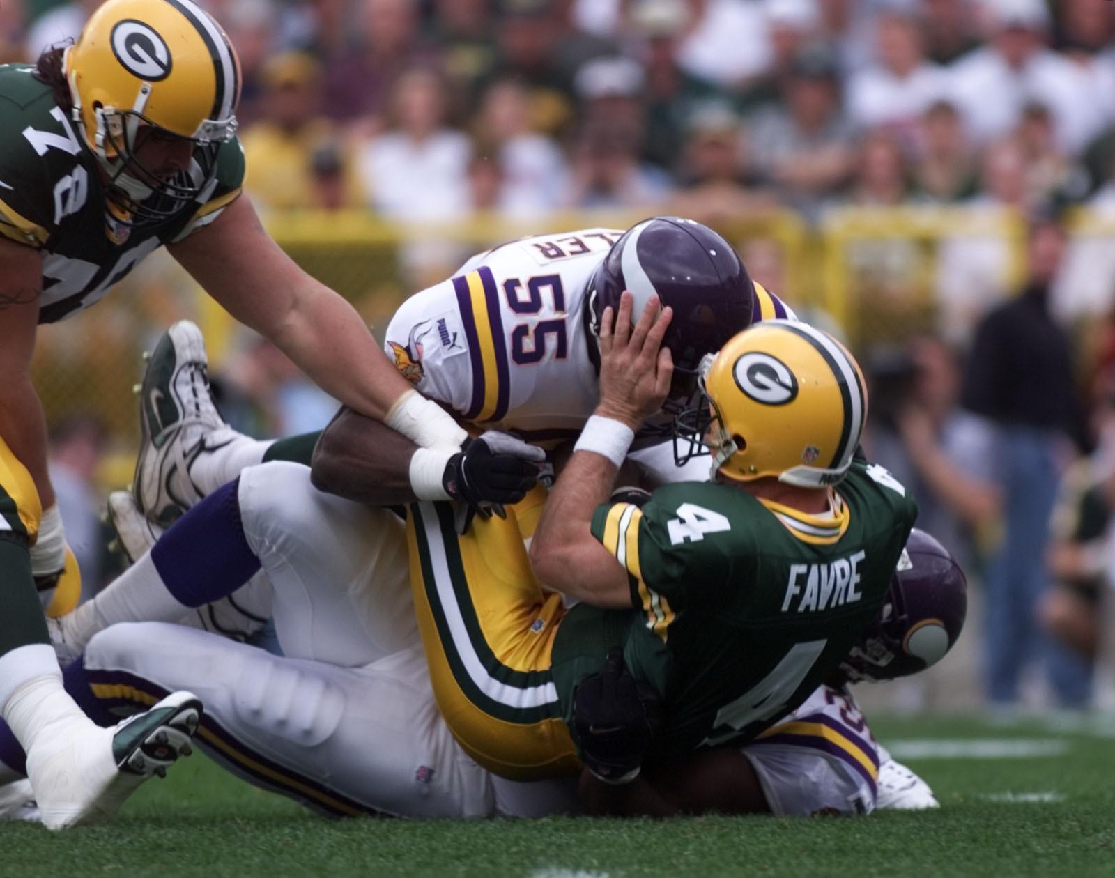 Vikings - Green Bay Packer football September 26,1999. -- Minnesota Vikings linebacker Corey Miller Cleans up on the first Brett Favre, 4, sack forced by Duane Clemons,92, during the 2nd quarter at Lambeau Field in Green Bay.