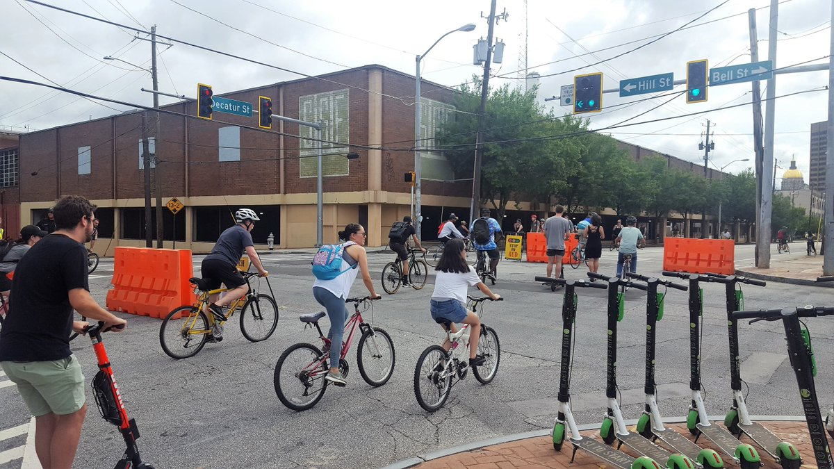 Cyclists and e-scooter patrons during a recent Atlanta Streets Alive, where non-motorists are protected from cars.