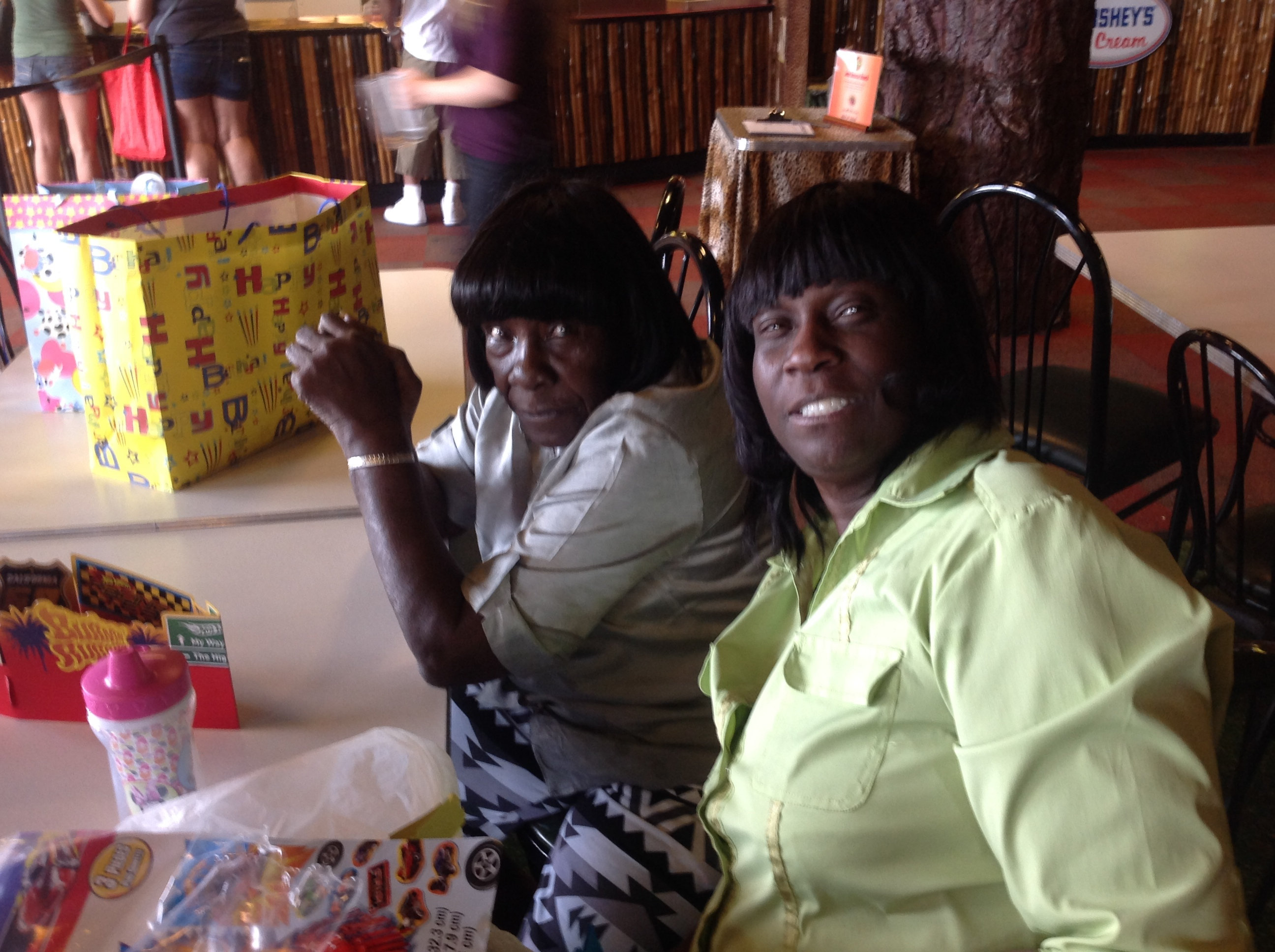 Sarah Crayton (right) and her mother at a family party on July 5, 2014, two days before a cardiology consultation that led to a heart test and complications.