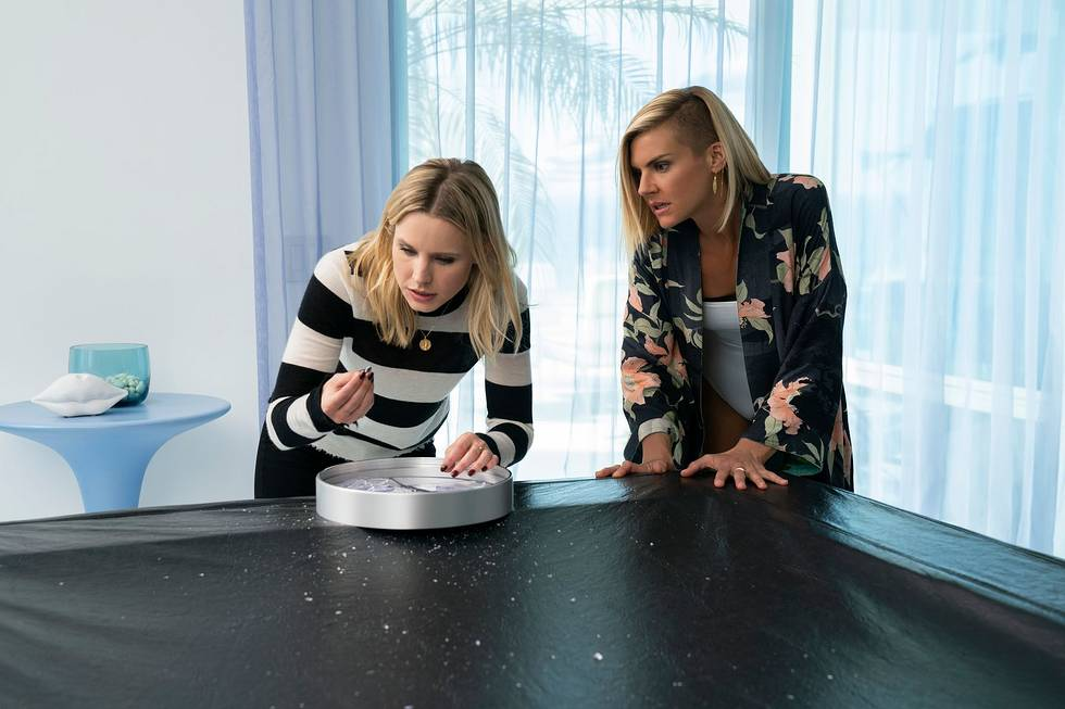 Veronica Mars, played by Kristen Bell, inspecting a clue in a publicity image for the show's fourth season.