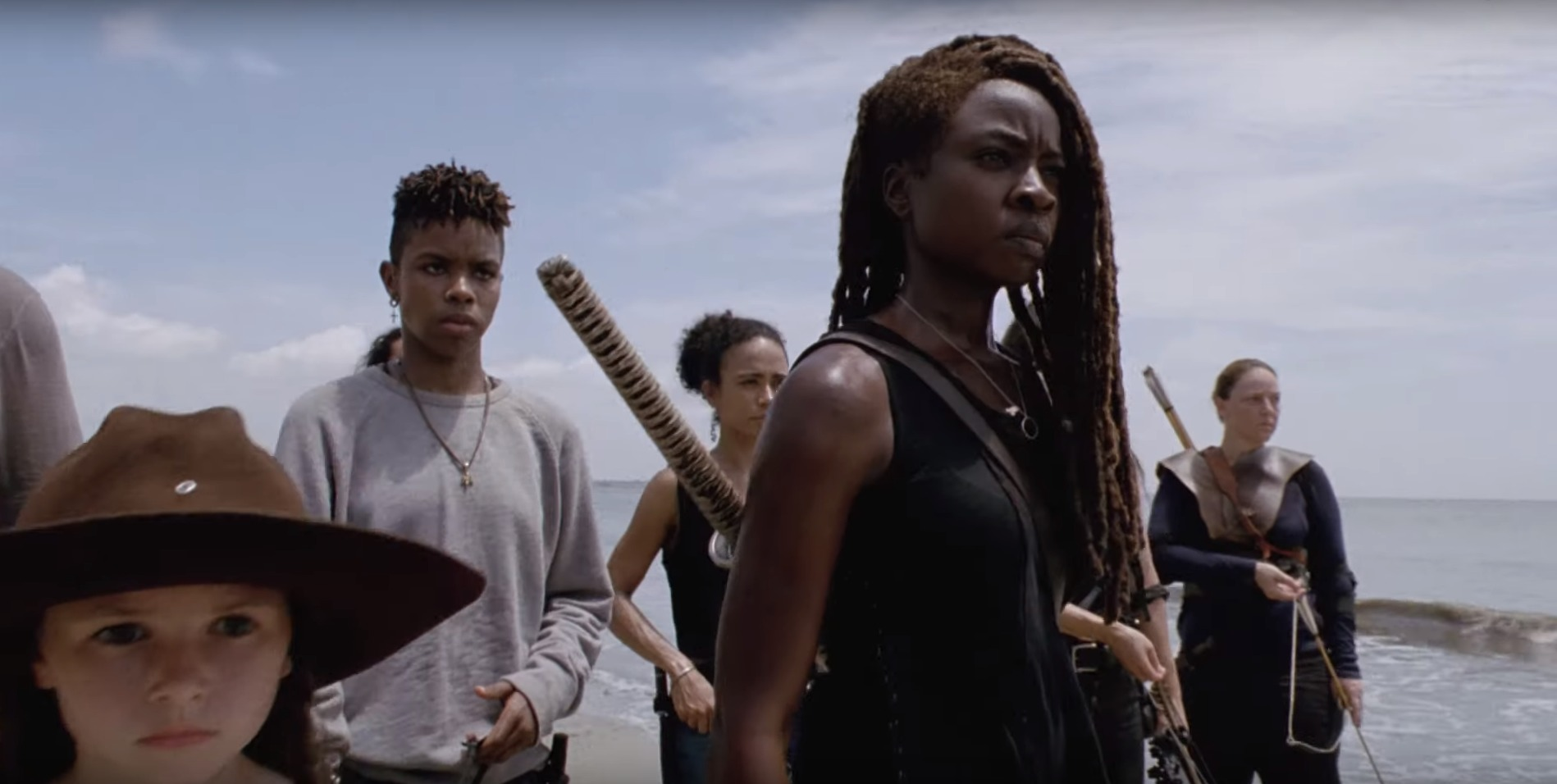 The Walking Dead - Michonne and several other survivors stand on a beach