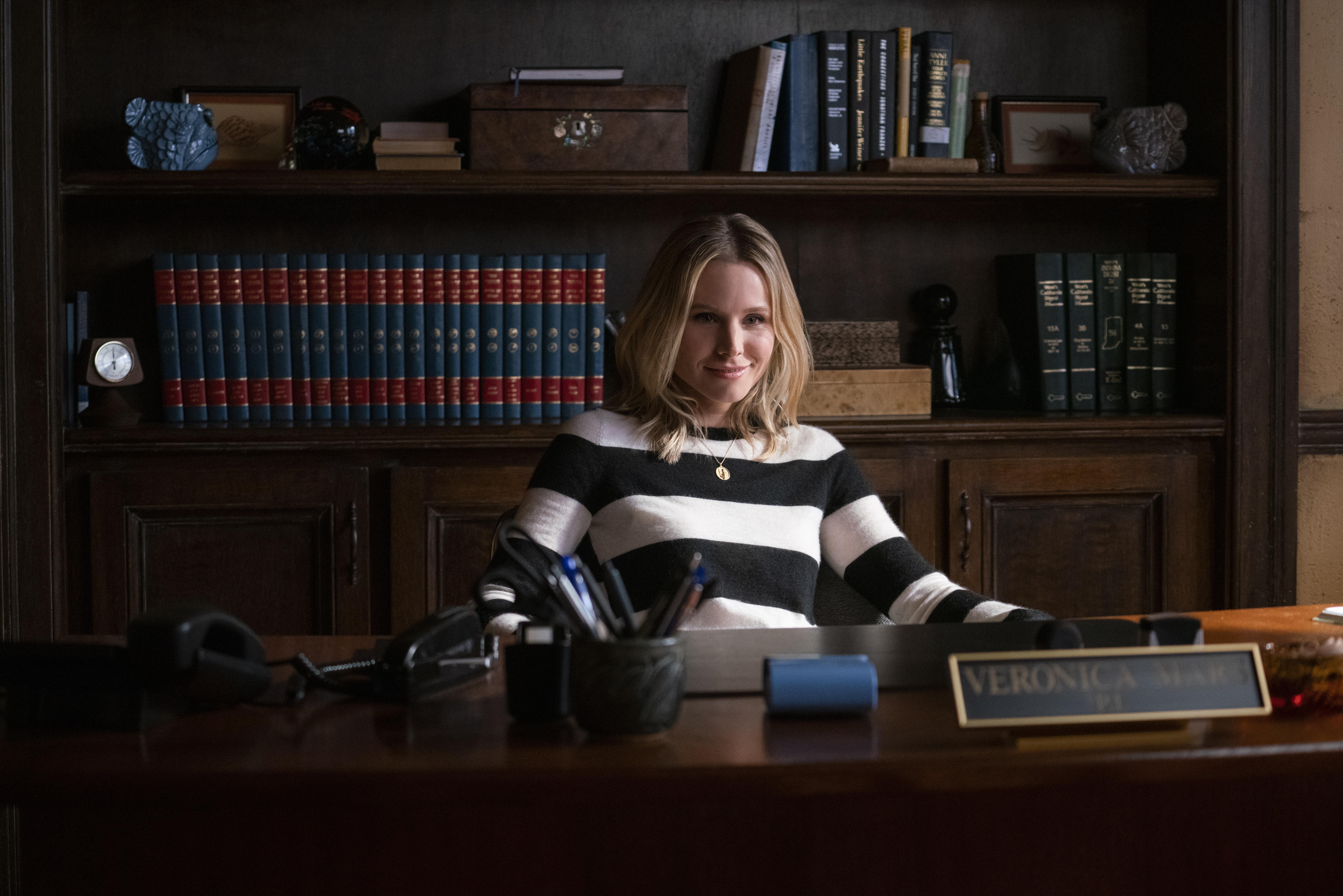 At her desk.