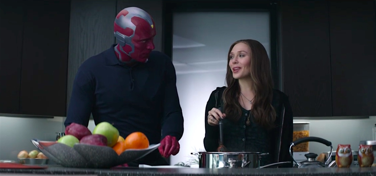 Vision and Wanda Maximoff (aka Scarlet Witch) cook dinner in a still from Captain America: Civil War