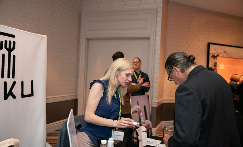 A businesswoman shows off a CBD product at the Arcview Investor Forum at the Fairmont Hotel Chicago on July 17, 2019.
