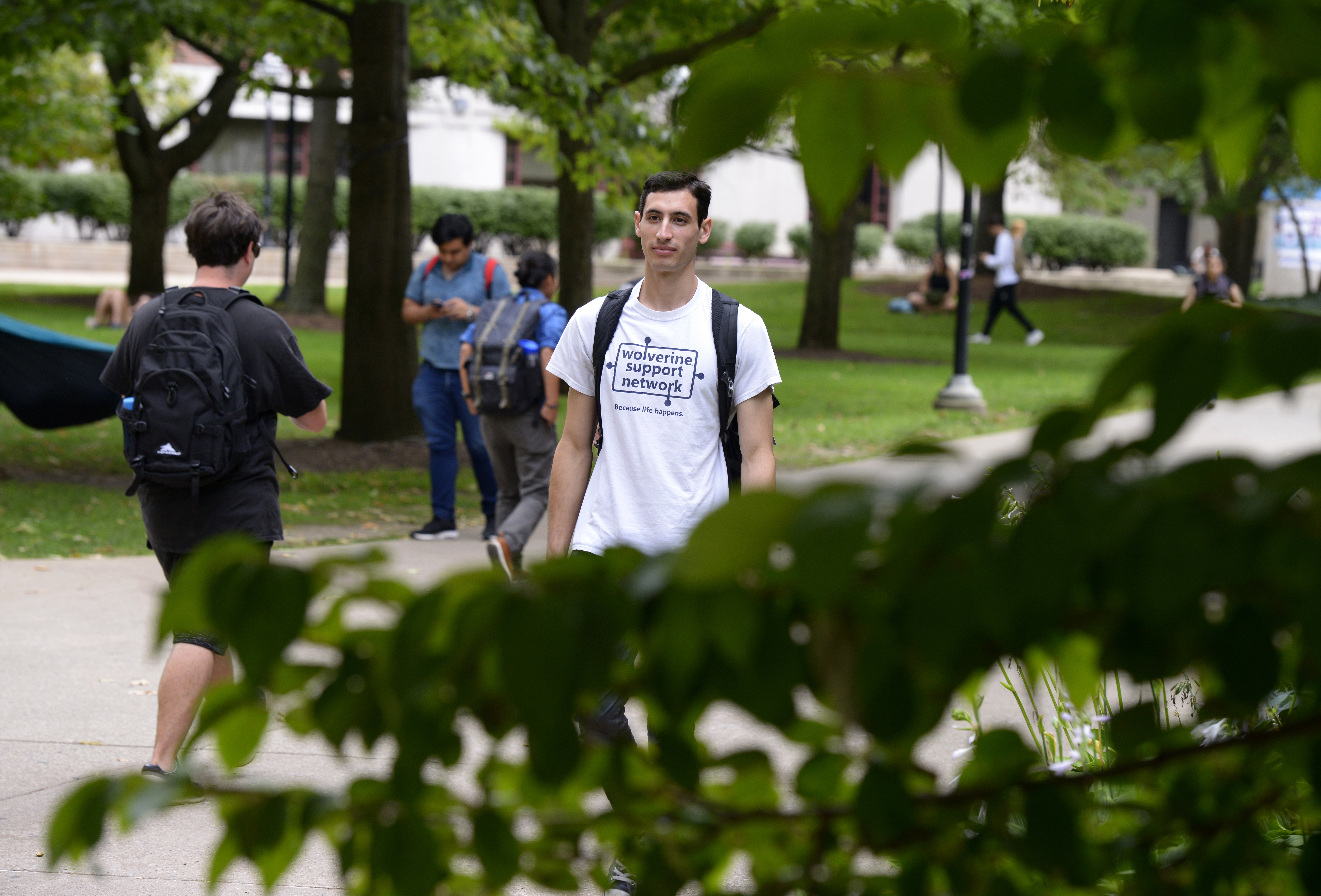 University of Michigan senior and Wolverine Support Network Executive Director Jordan Lazarus walks on campus at the school in Ann Arbor, Mich., on Wednesday, Sept. 12, 2018. The peer-to-peer group is designed to empower students to create a safe communit