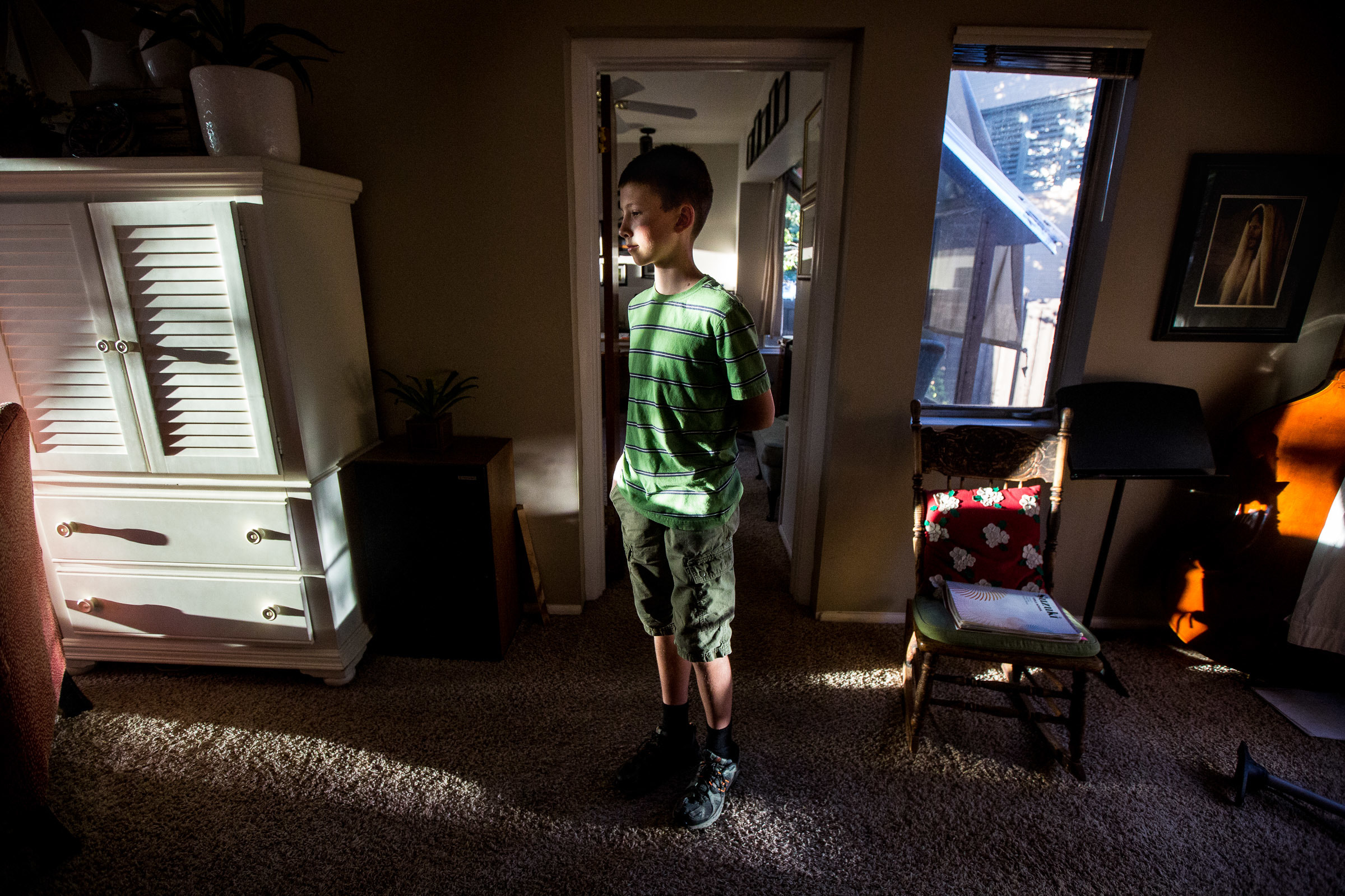 Owen, 12, gets ready for a backyard game called kubb with his family at his home in the Salt Lake area on Monday, Sept. 17, 2018. Owen was diagnosed with anxiety, and his family has learned how to help and support him as he copes with his anxious tendenci