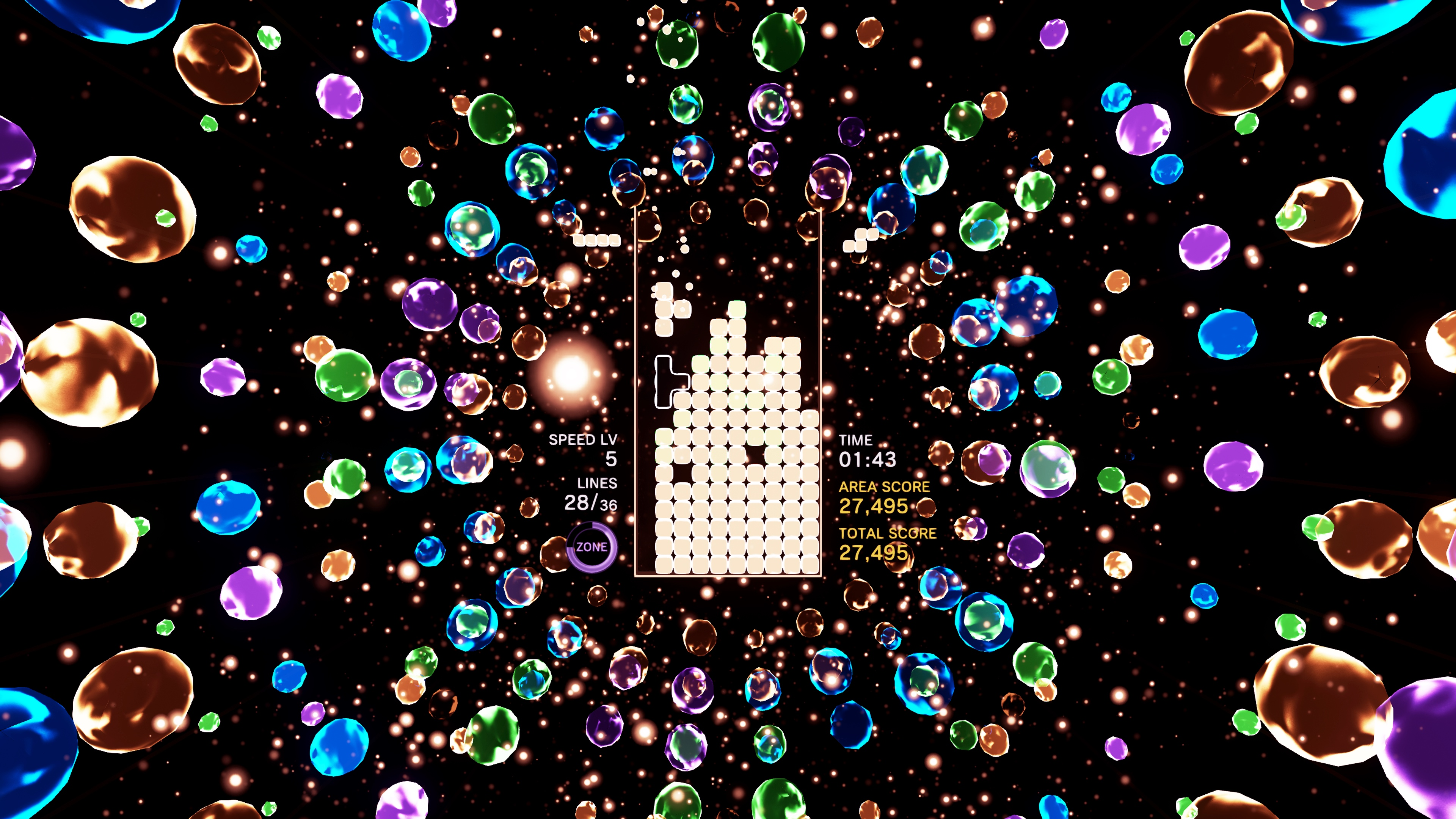 A T-shaped piece falls onto a bright puzzle field in a screenshot from Tetris Effect