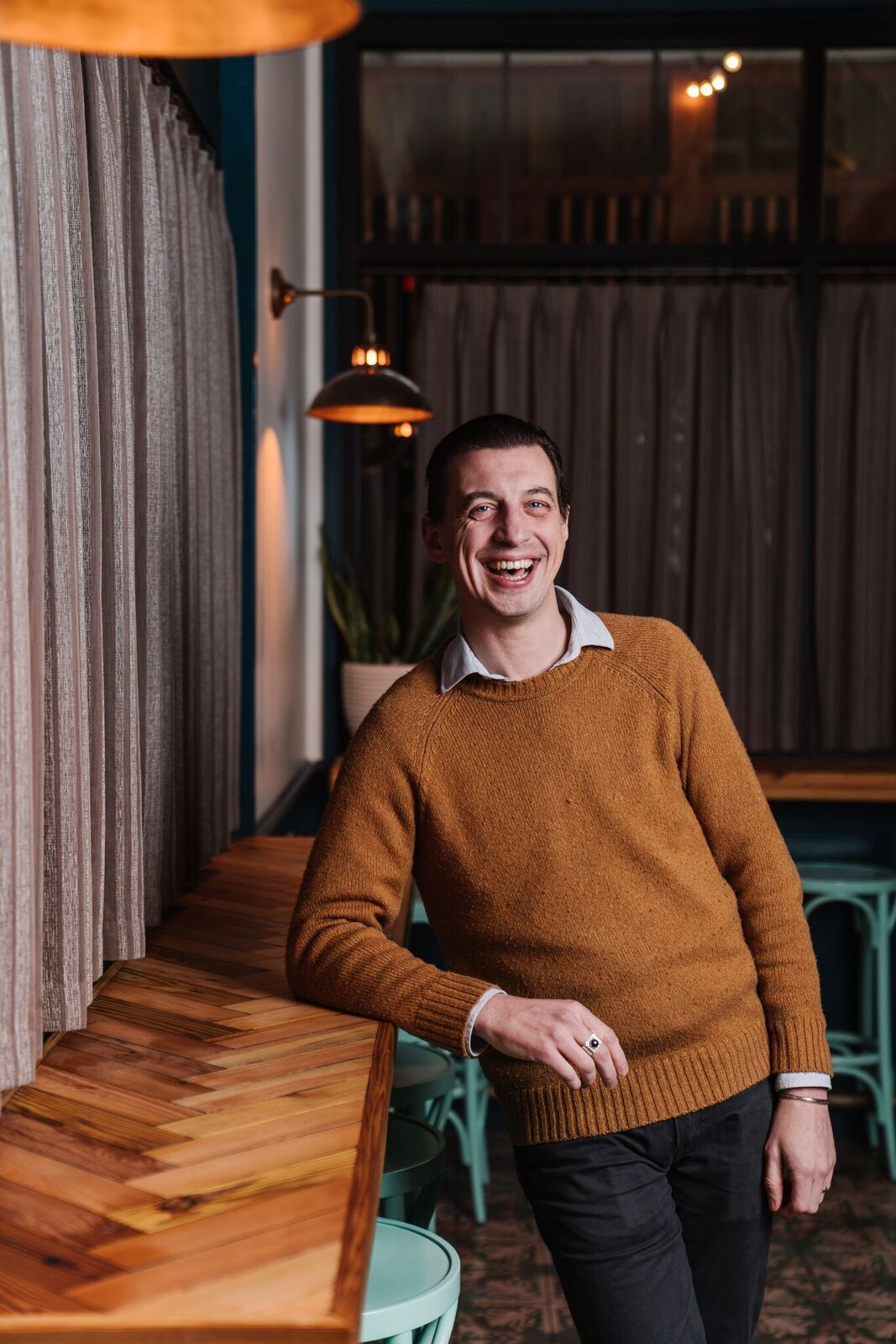 Jesse Smith leans on the bar at Kimball House
