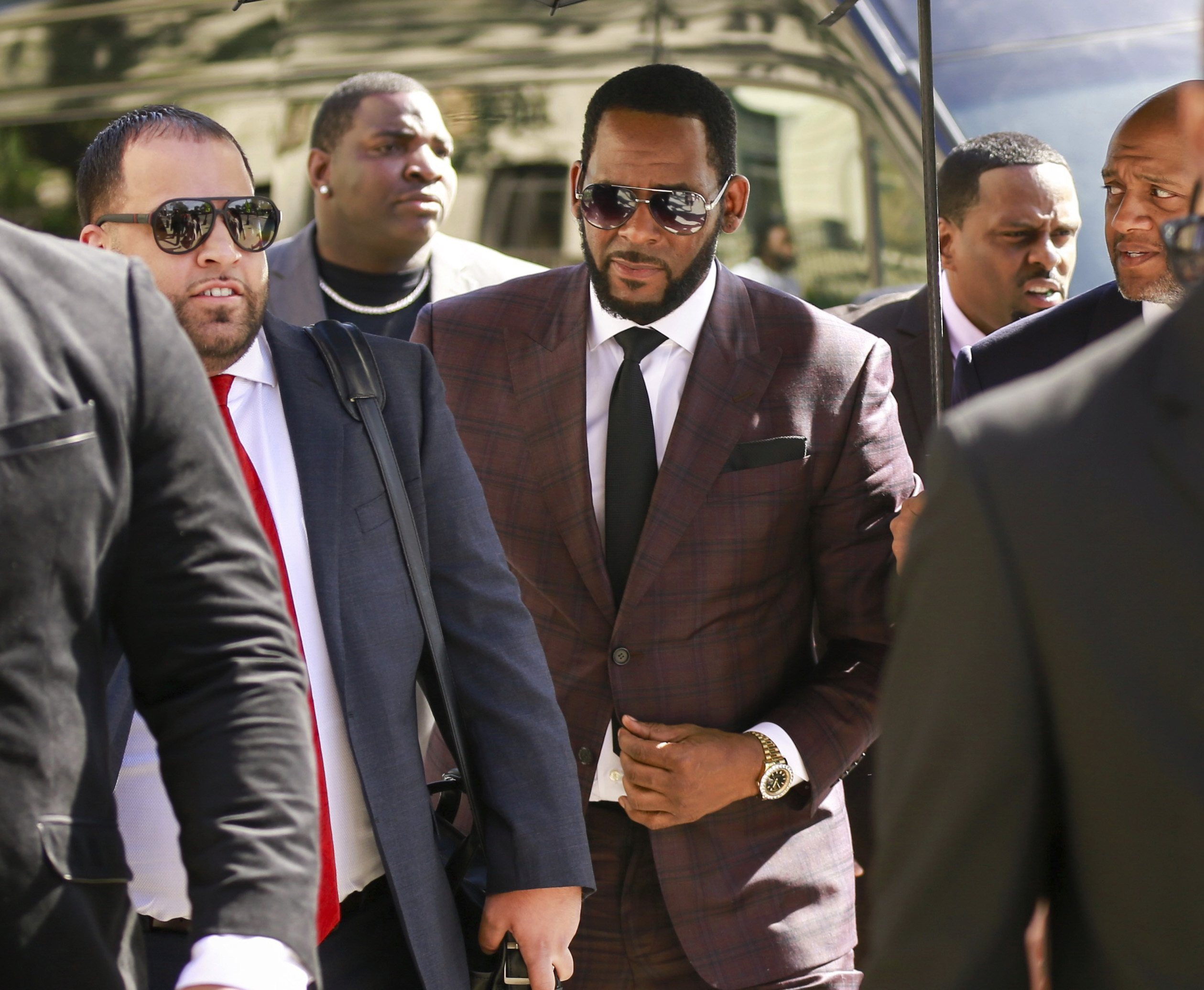 In this June 26, 2019, file photo, R&B singer R. Kelly, center, arrives at the Leighton Criminal Court building for an arraignment on sex-related felonies in Chicago.