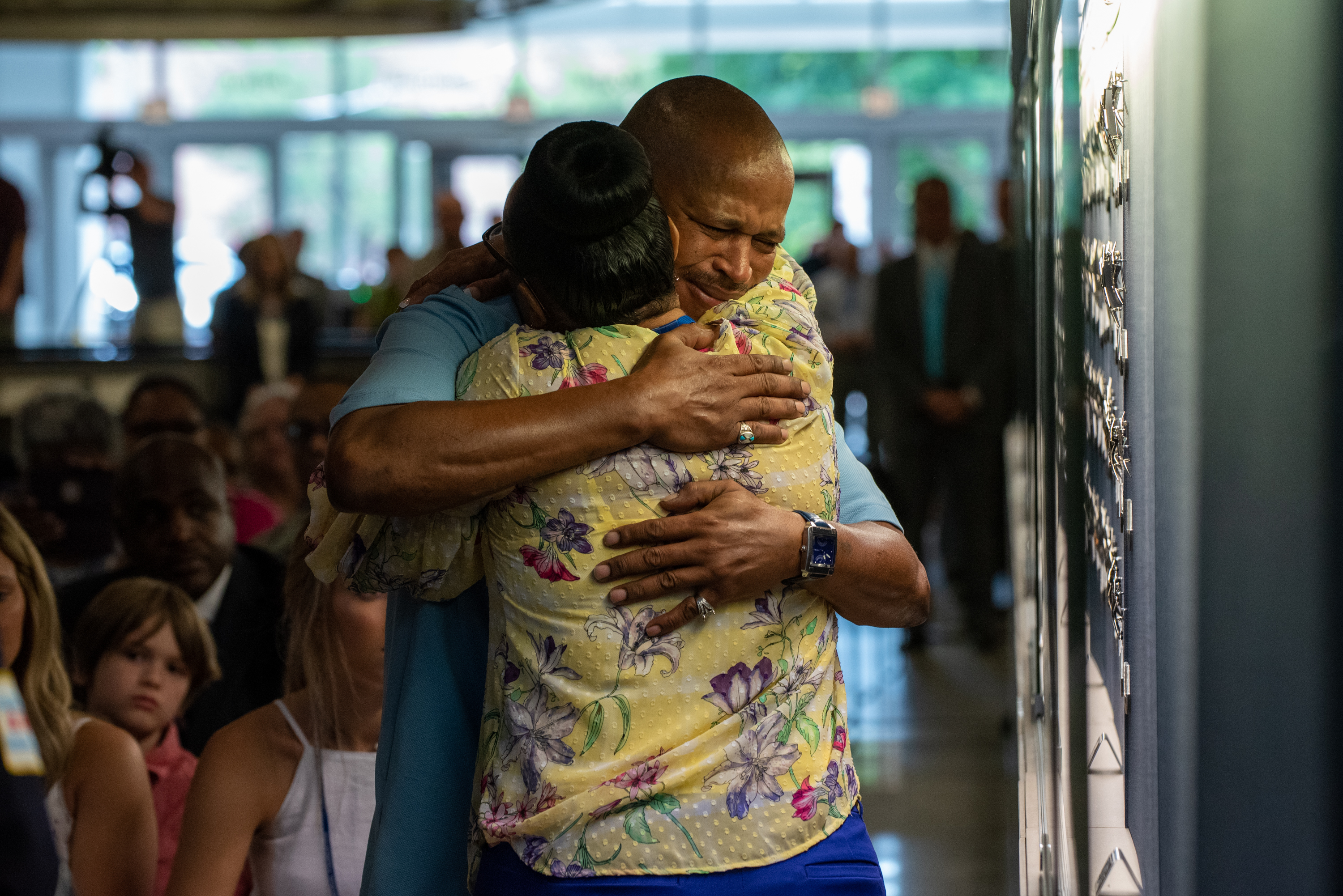 """Artis Jackson hugs his sister, Ansonia Richardson, moments after honoring their deceased father, Chicago Police Officer Arthur O. Jackson, by placing his police star in the """"Honored Star Case"""" at police headquarters Tuesday."""