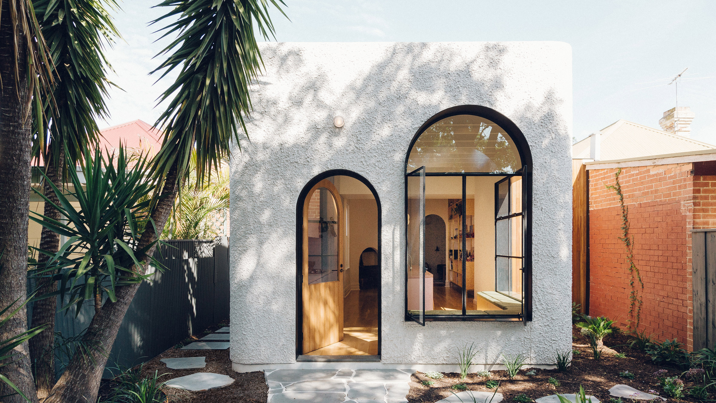 Stylish stucco home is all curves and color