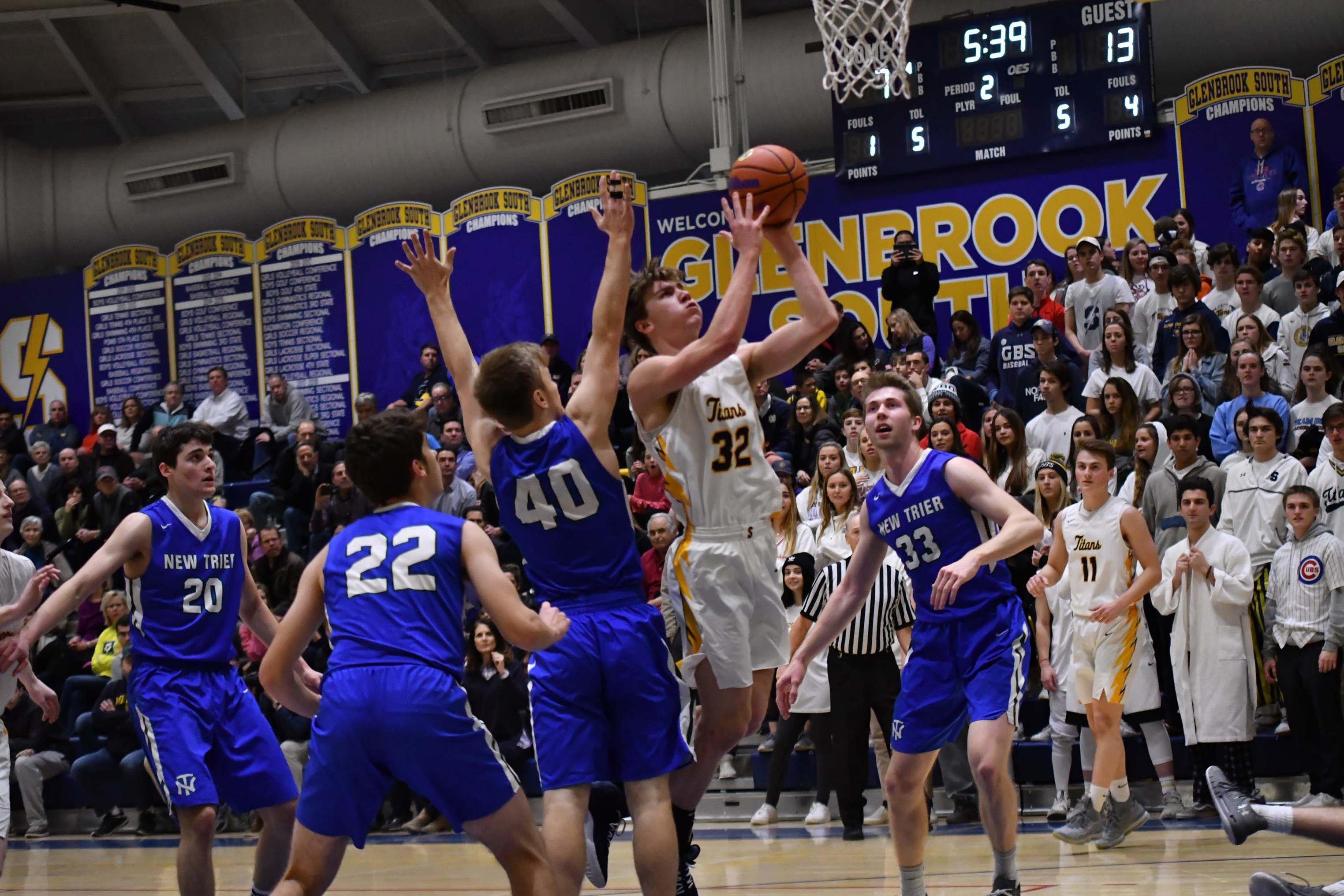 Glenbrook South's Dom Martinelli (32) makes a basket against New Trier.